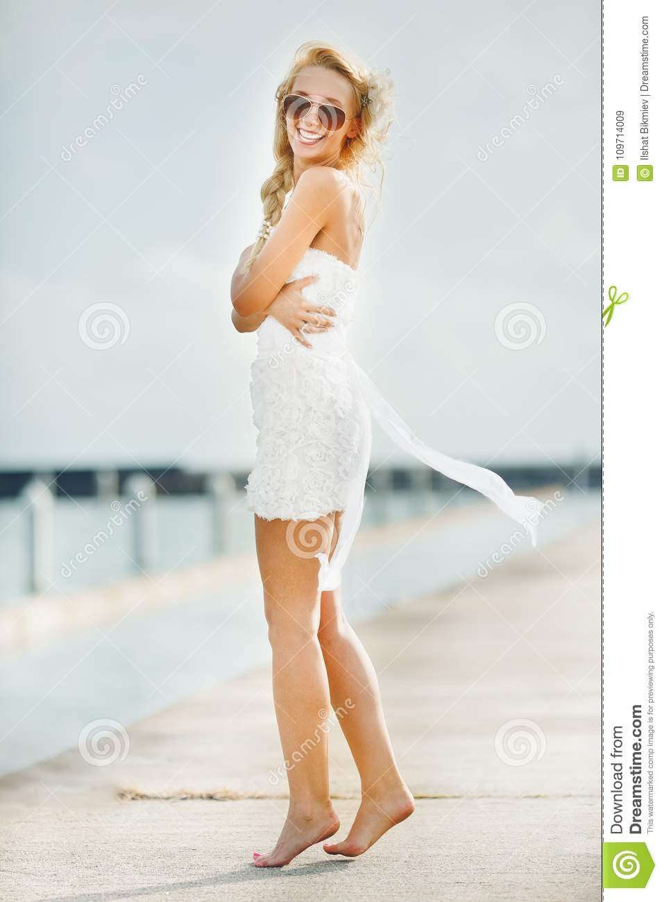 Smiling Woman In White Short Wedding Dress Bride In Glasses With