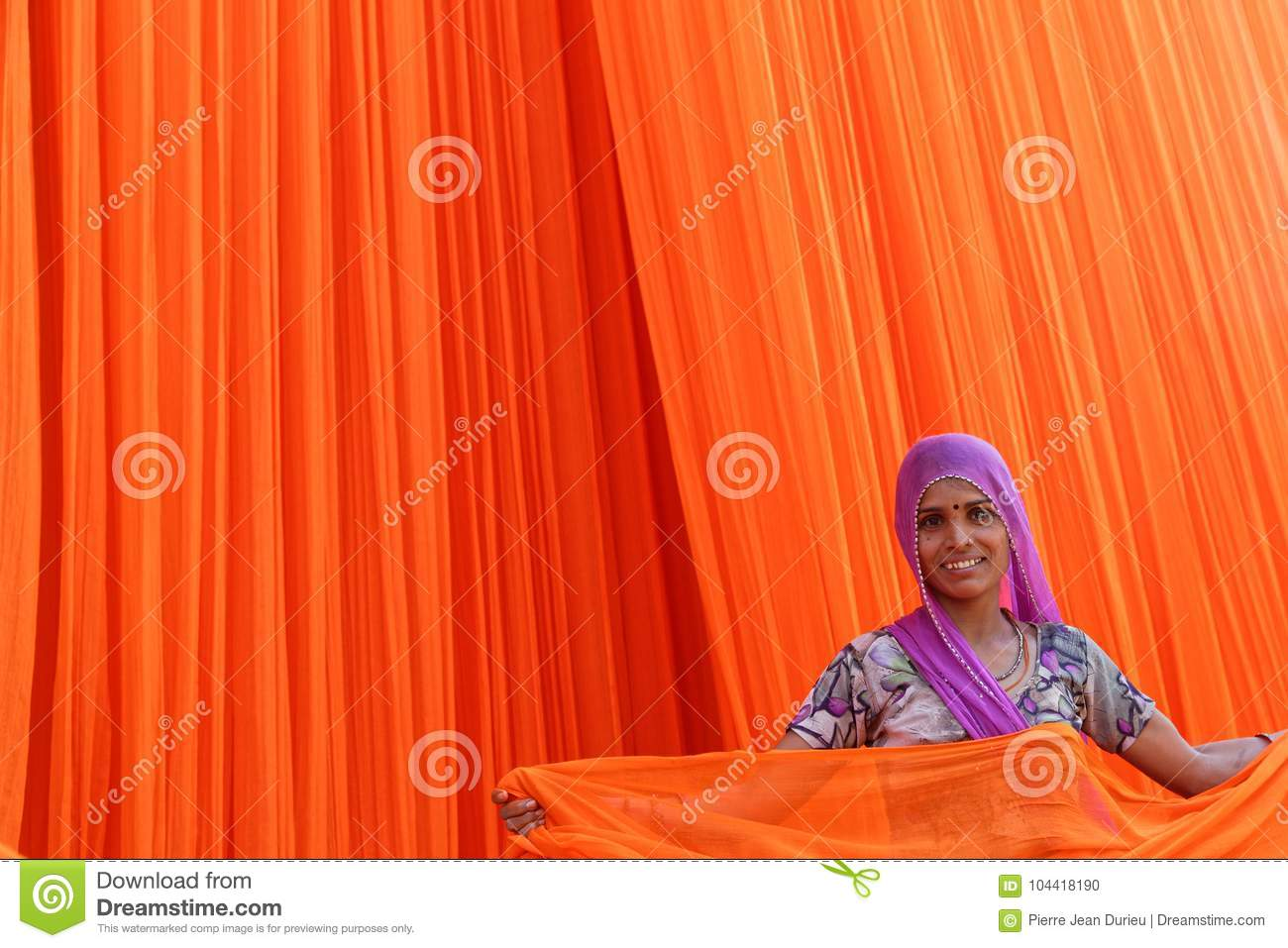 Smiling woman working in textile factory