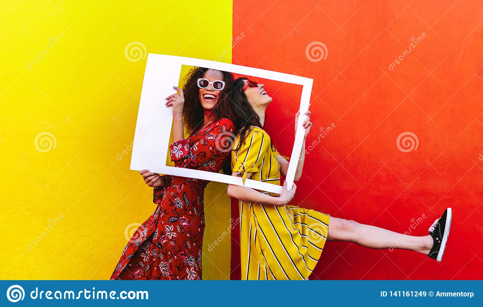 Smiling women with empty photo frame