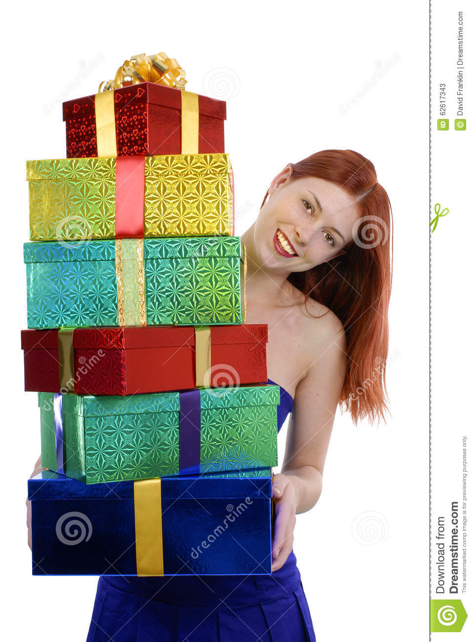 Smiling Young Adult Woman In Blue Party Dress With Pile Of Christmas ...