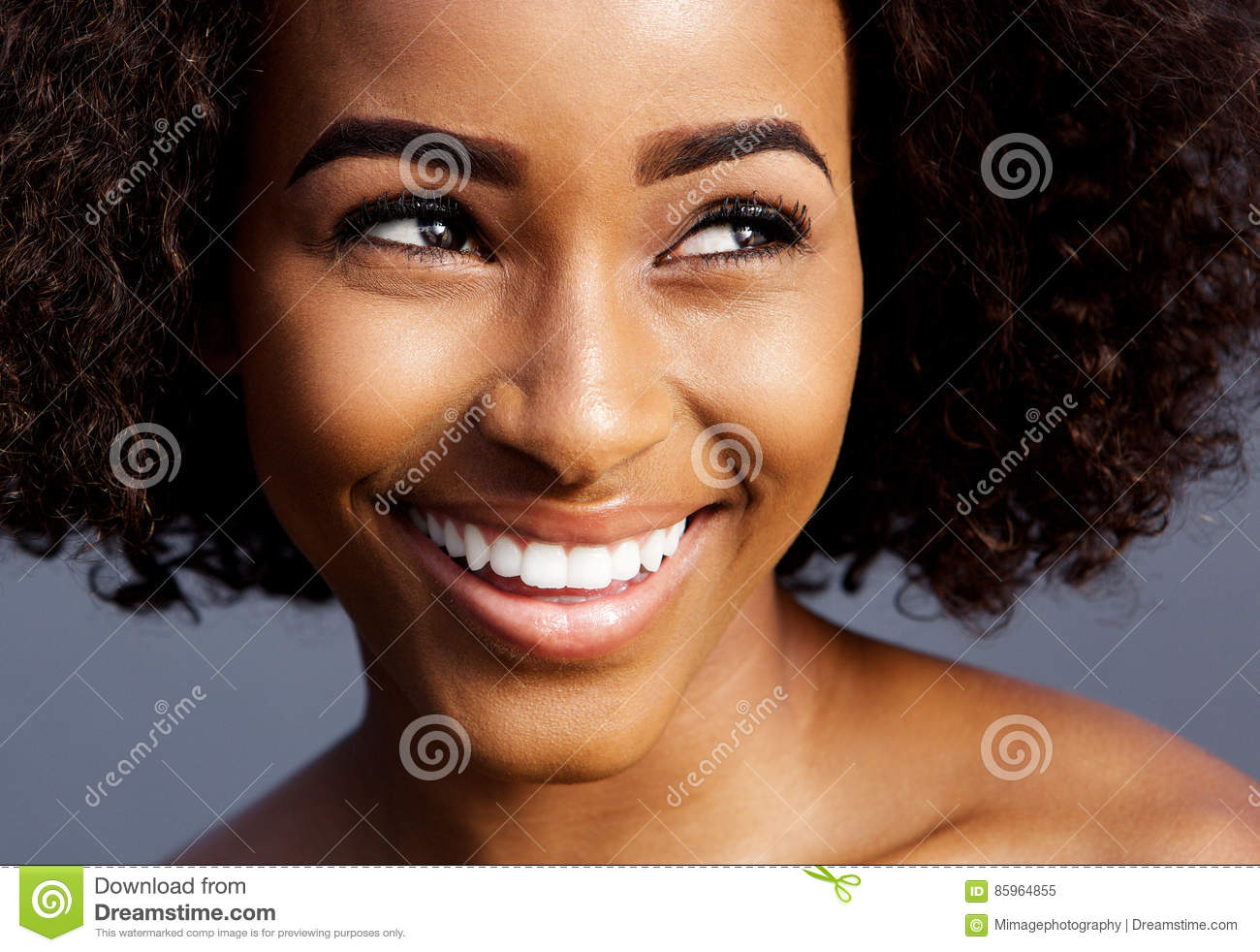 Smiling Young Black Woman With Curly Hair Looking Away Stock Image