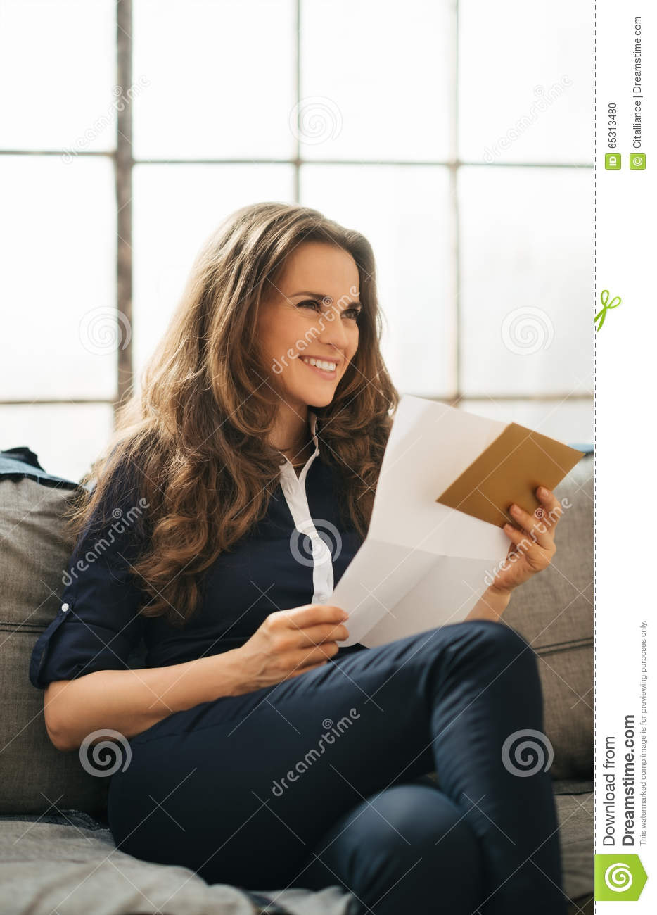 Smiling Young Brown Haired Woman Holding Letter Stock