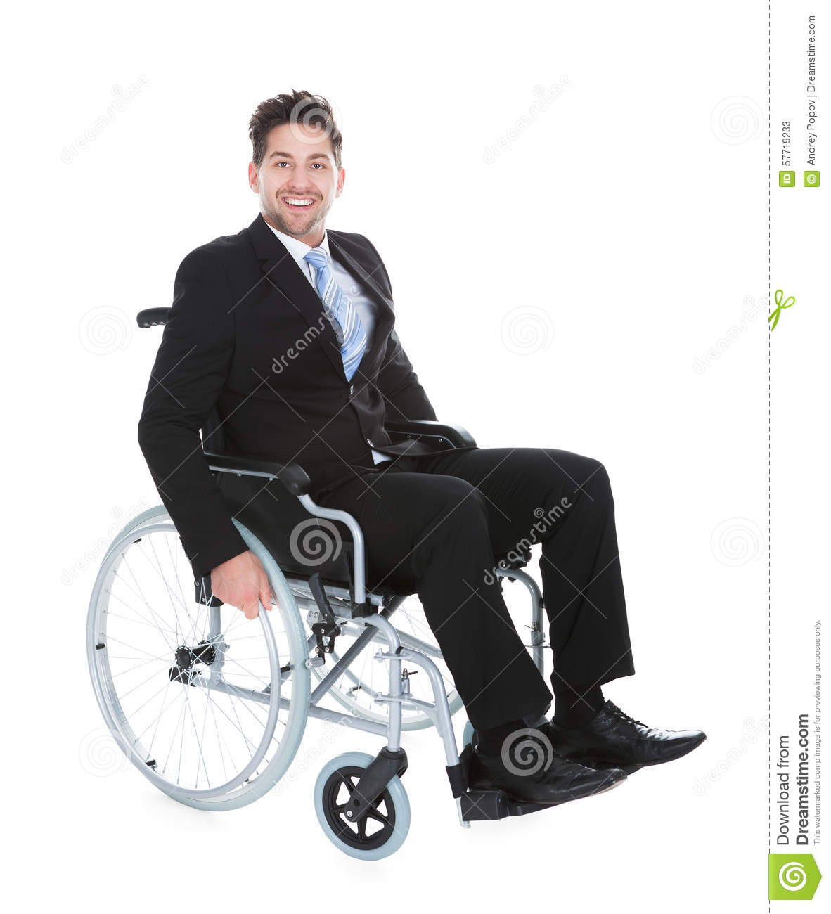 Smiling Young Businessman Sitting On Wheelchair