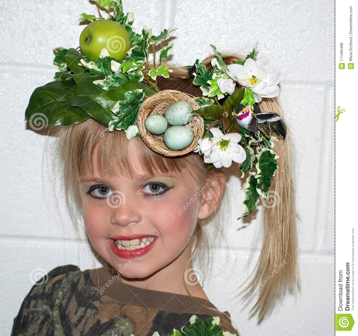 Young girl with floral hat