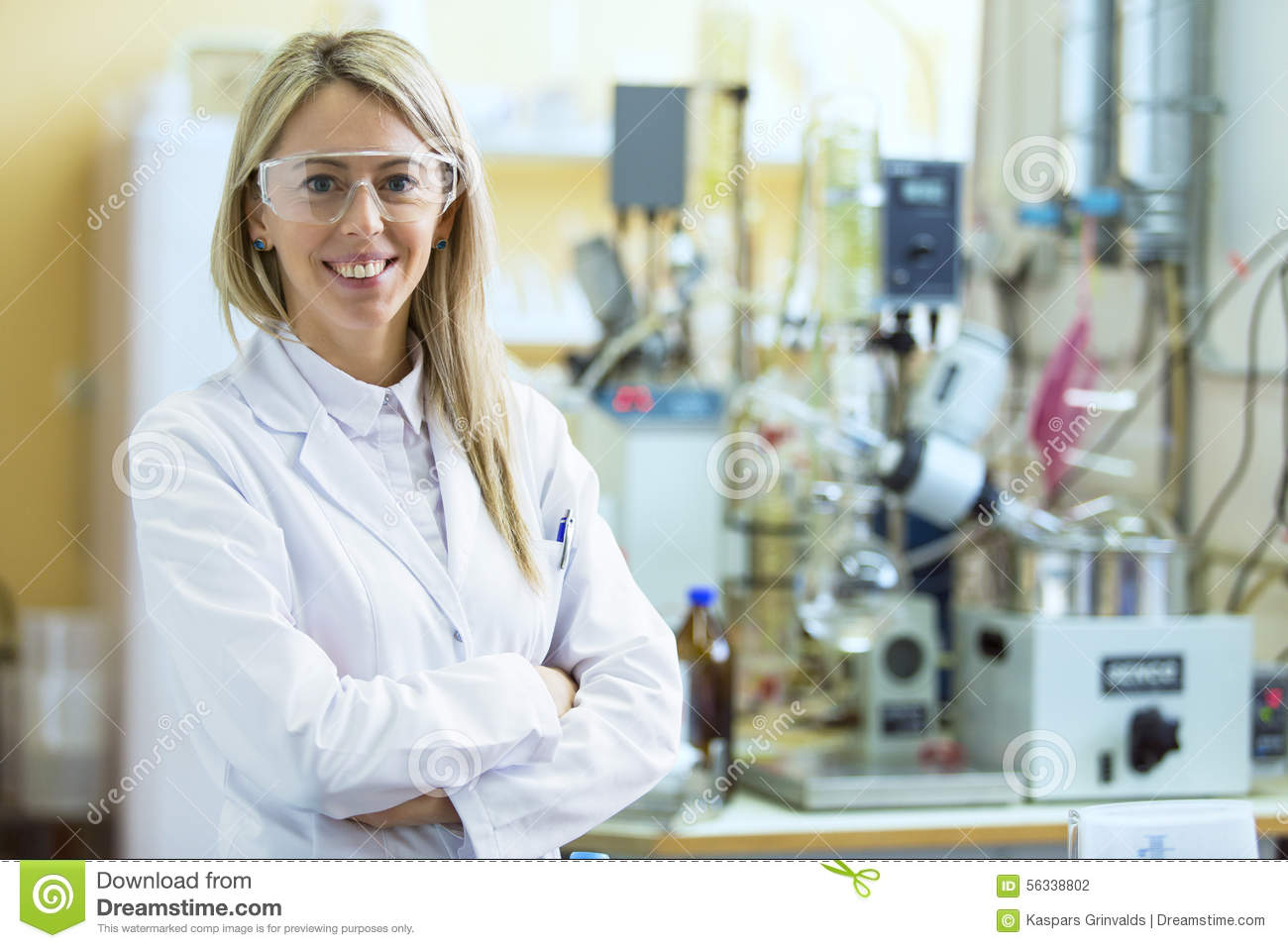 smiling young chemist in chemistry lab