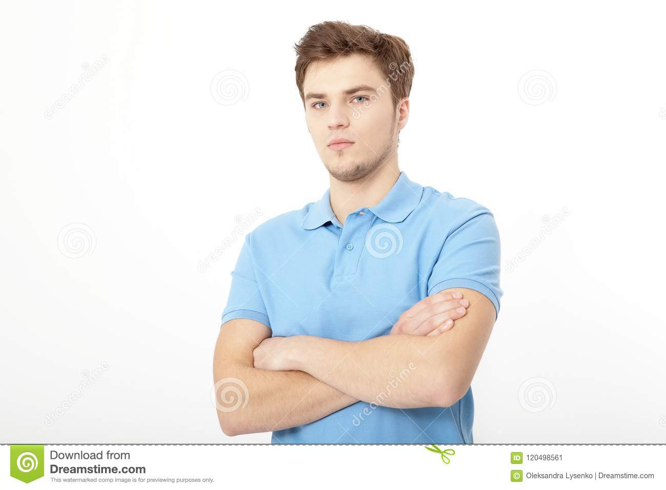 Smiling young man portrait isolated on white background. Copy space. Mock up. Handsome guy. Summer shirt clothes. Crossed arms
