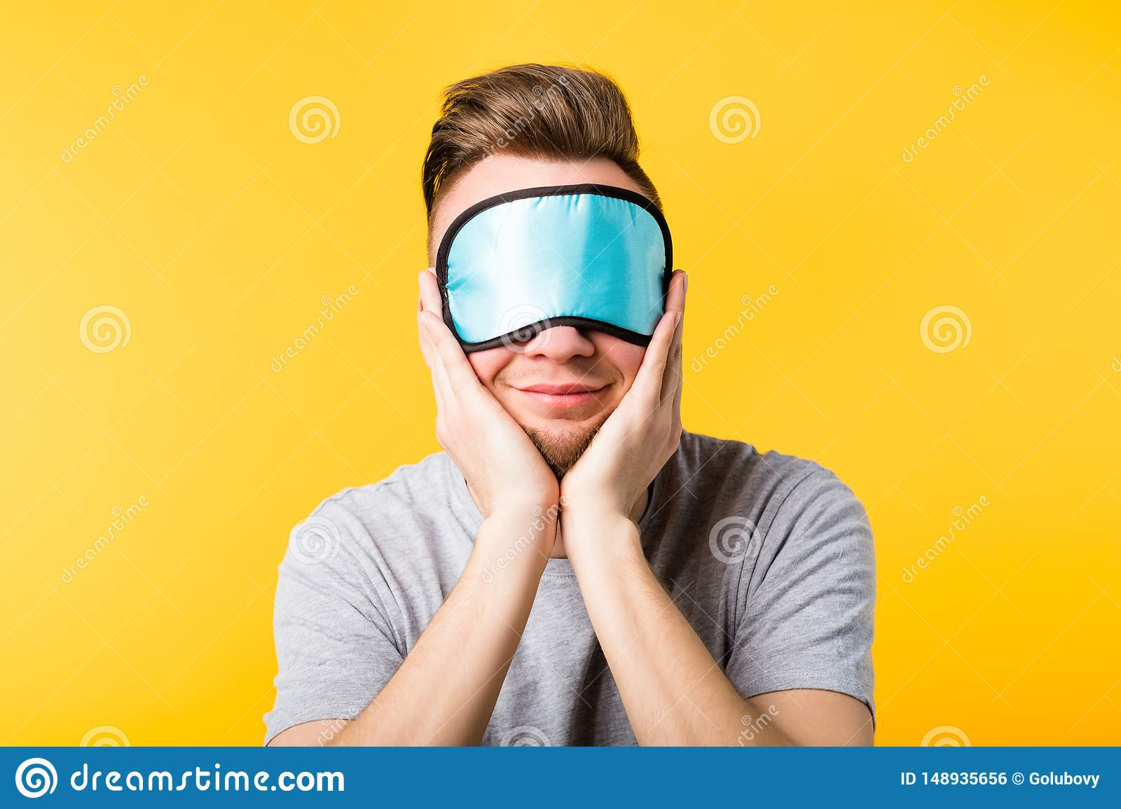 Smiling man sleep mask care relaxation rest