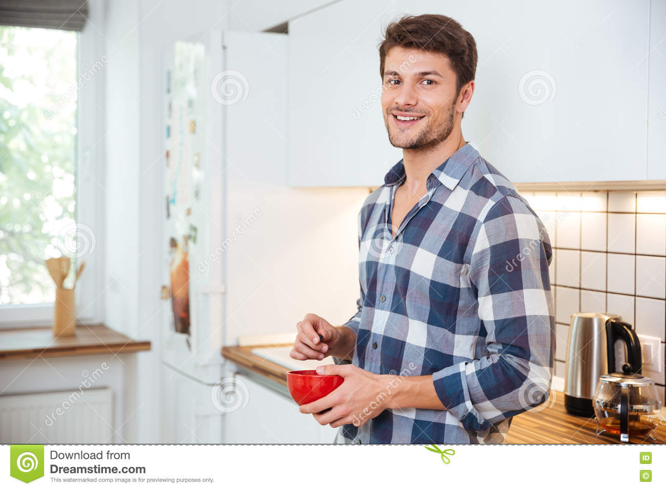 Smiling Young Man Standing On The Kitchen Stock Photo - Image ...