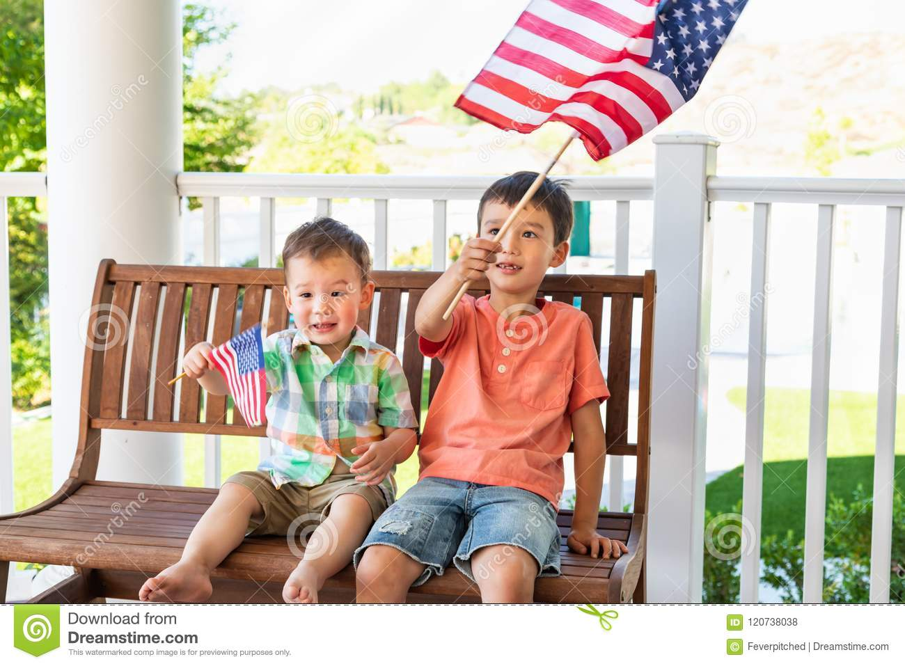 Smiling Young Mixed Race Chinese Caucasian Brothers Playing With American Flags