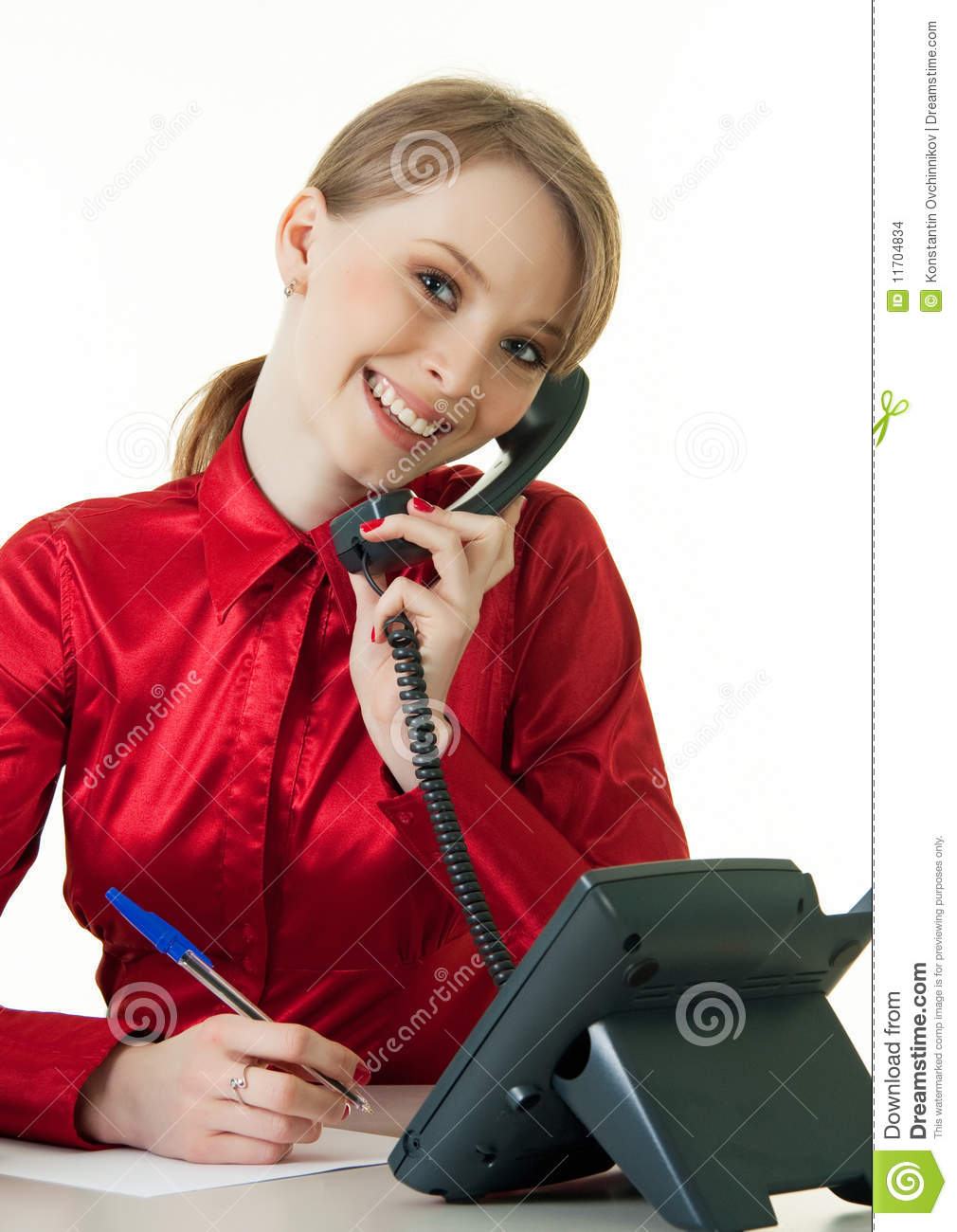 Smiling Young Receptionist Using Desk Phone Stock Images