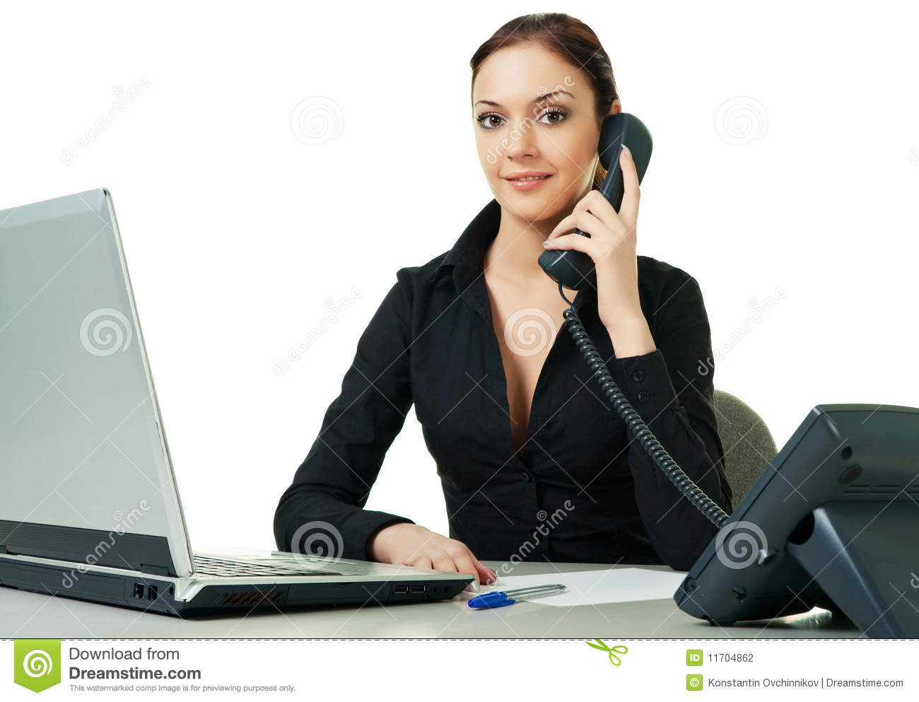 Smiling Young Receptionist Using Desk Phone Stock