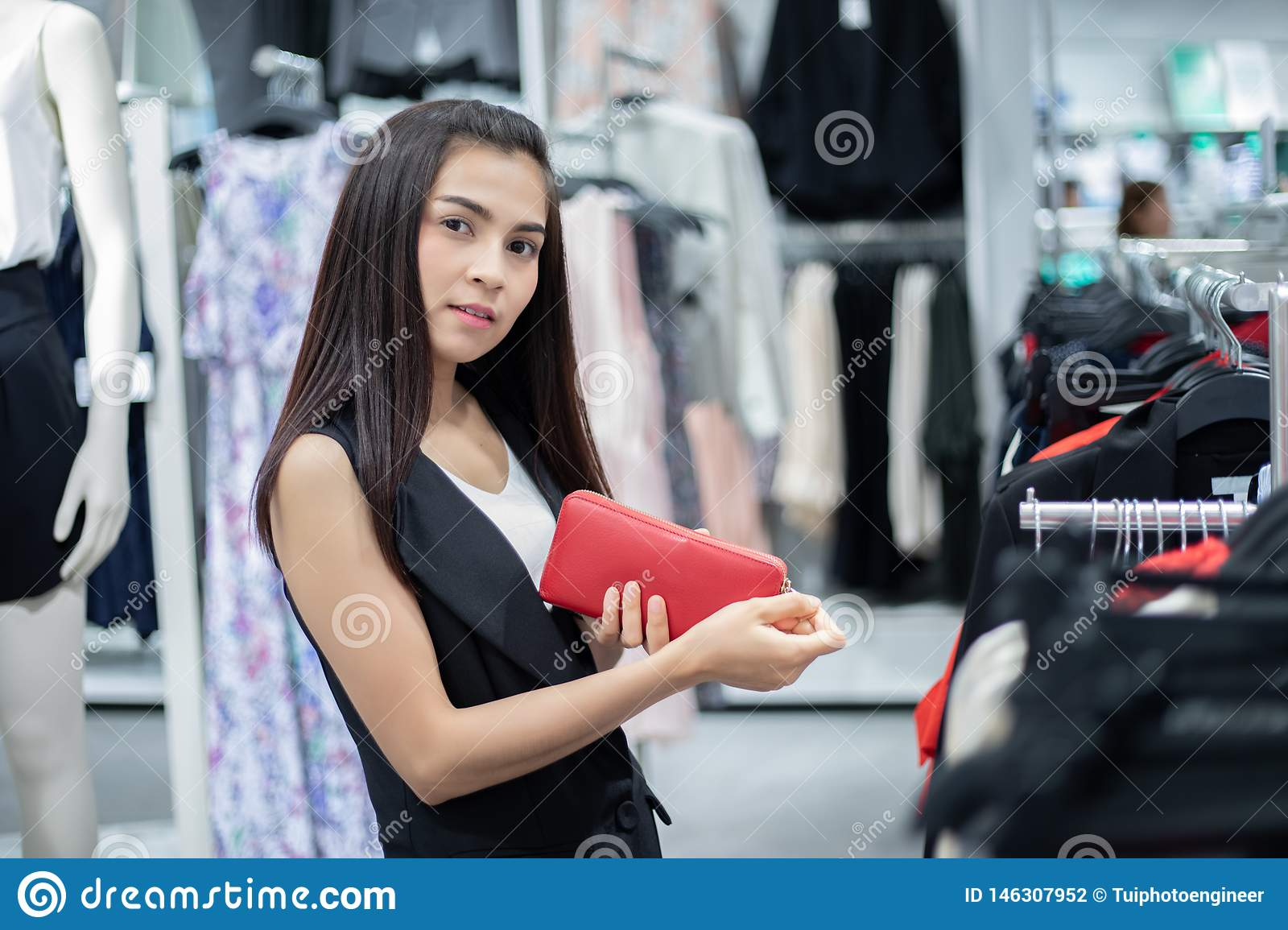 Smiling young woman Asian with shopping and buy with credit card at mall/supermarket/market