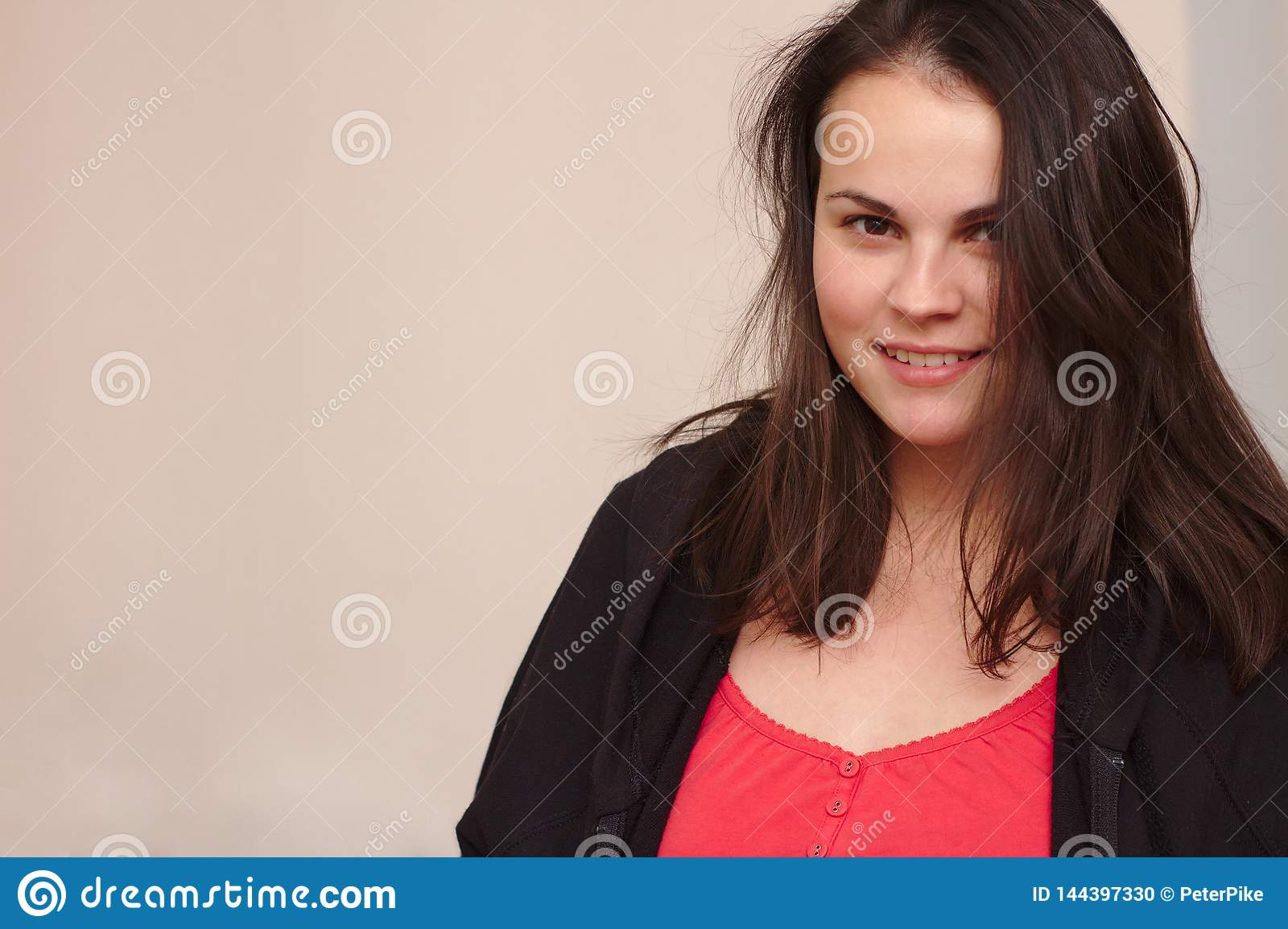smiling young woman in casual clothes. Portrait plus size model on background