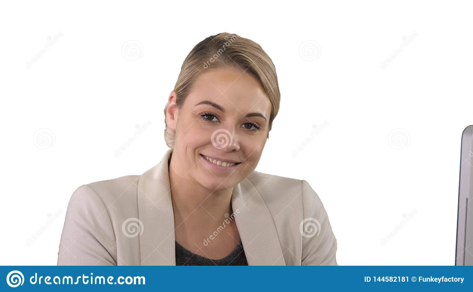 Smiling young woman looking at camera, white background