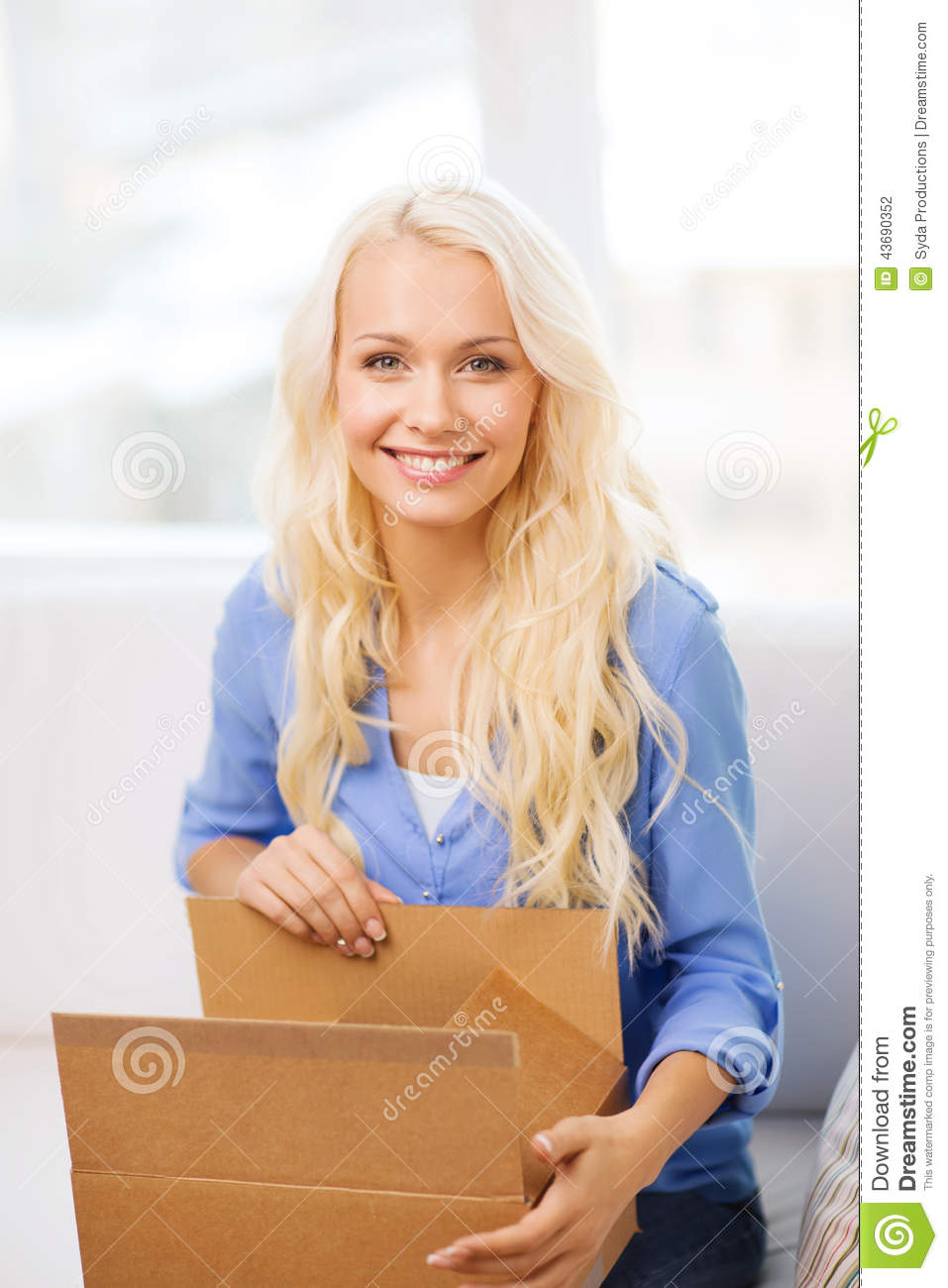 Smiling Young Woman Opening Cardboard Box Stock Photo ...