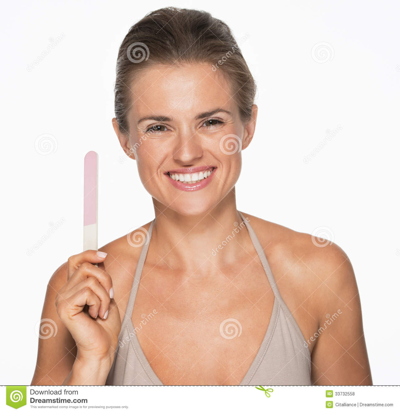 Smiling young woman showing nail file