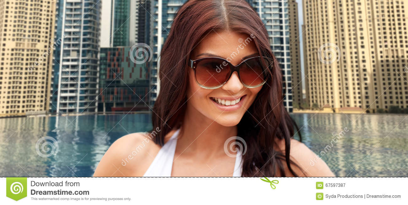 Smiling Young Woman With Sunglasses Over City Pool Stock Image 67597387
