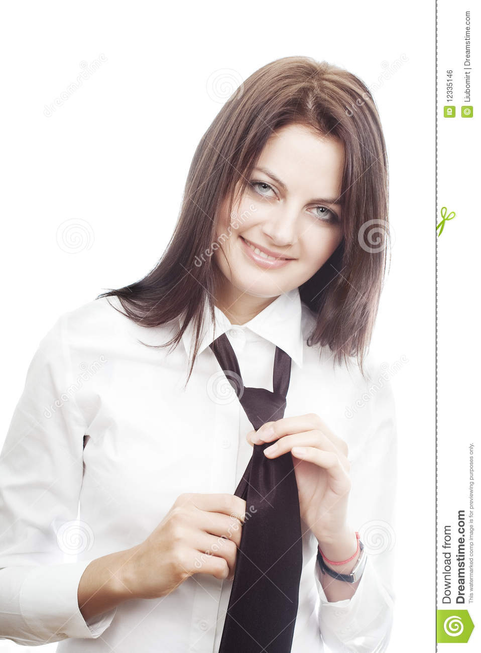 Smiling young woman tying a tie stock photo image of confident download comp ccuart Gallery