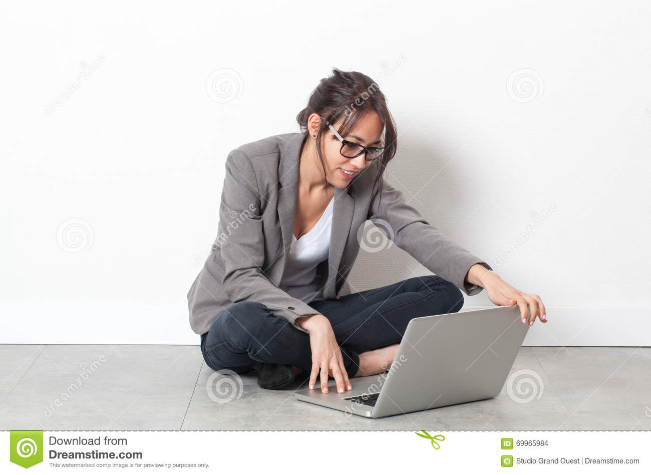 Smiling Young Woman Working On Computer Relaxing On The
