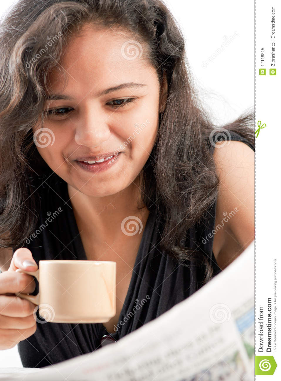Smilling indian teen reading newspaper with coffee - smilling-indian-teen-reading-newspaper-coffee-17118815