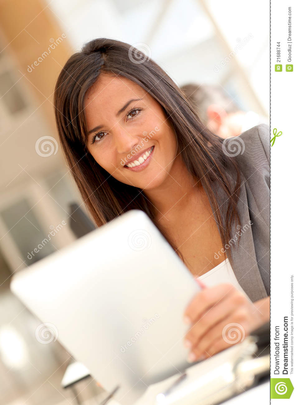 Smilng office worker with tablet