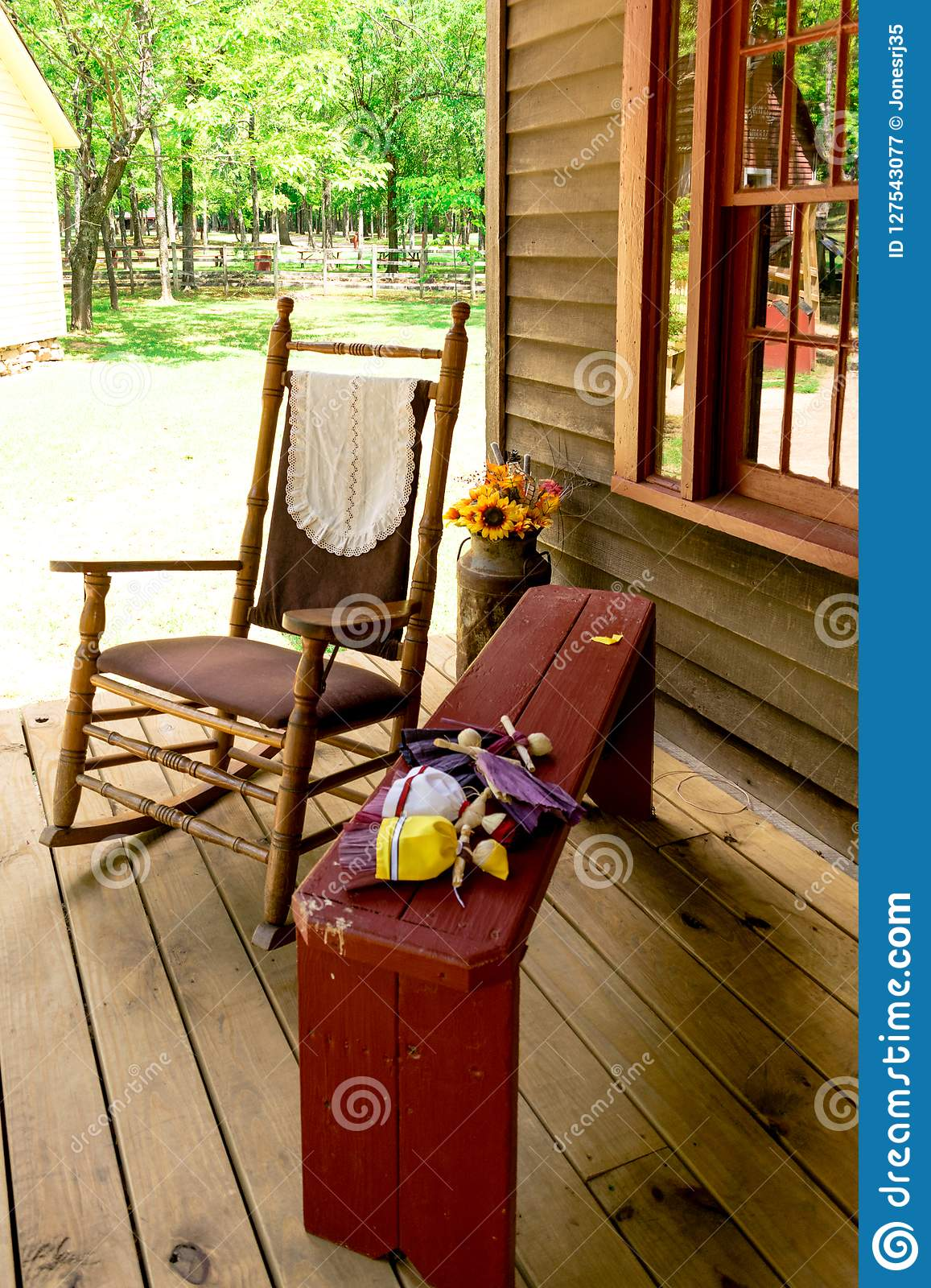 Fantastic General Store Porch With Rocking Chair And Bench Stock Image Ibusinesslaw Wood Chair Design Ideas Ibusinesslaworg