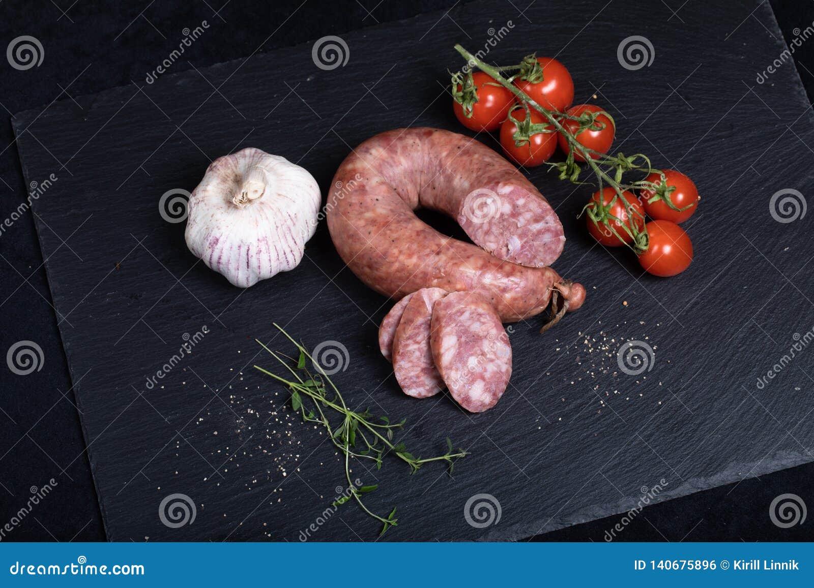 Smocked sausage on black stone plate