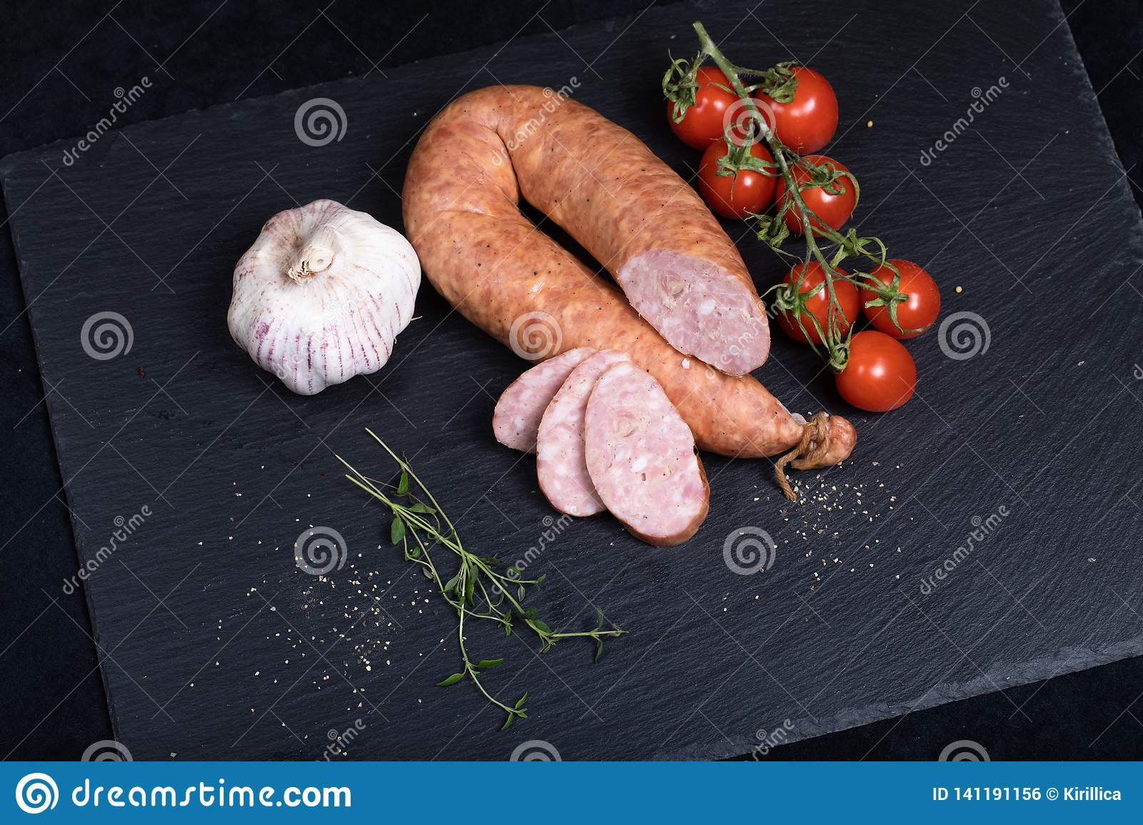 Smocked sausage on black stone plate