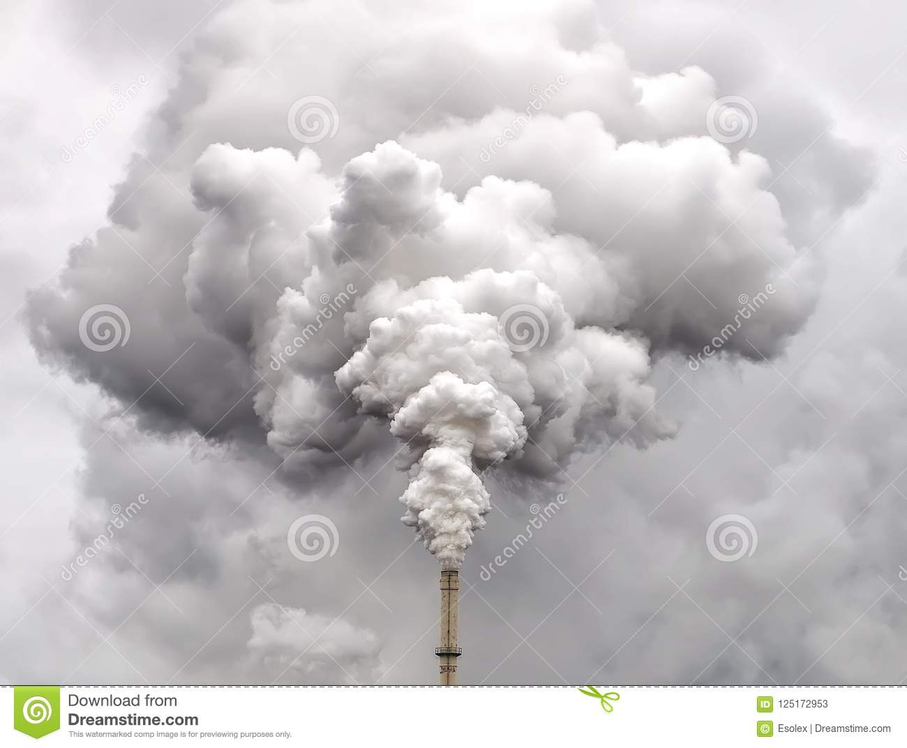 Smoke from factory pipe against overcast sky