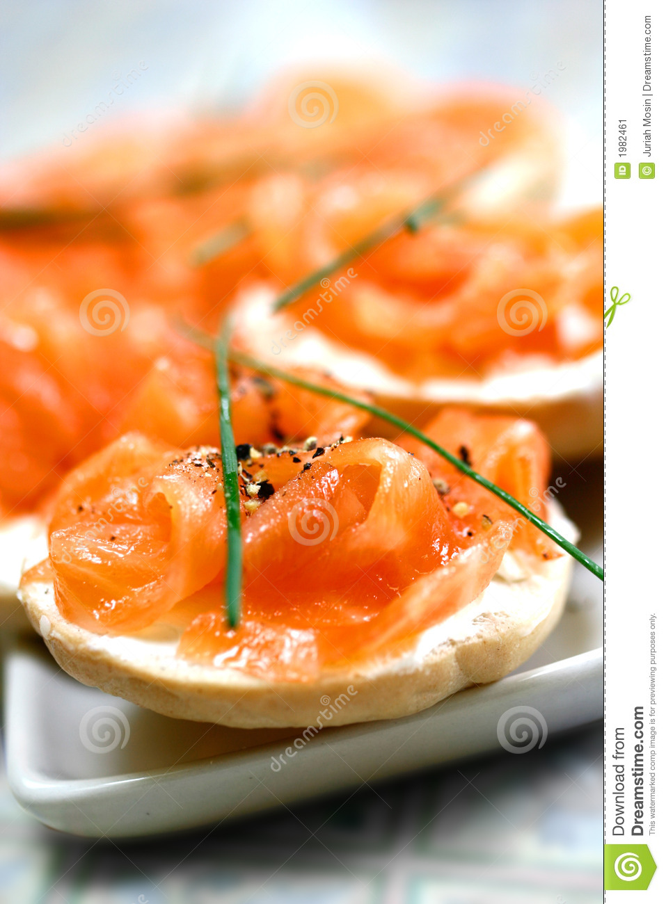 Smoke salmon on cream cheese on mini bagel with a dash of freshly ...