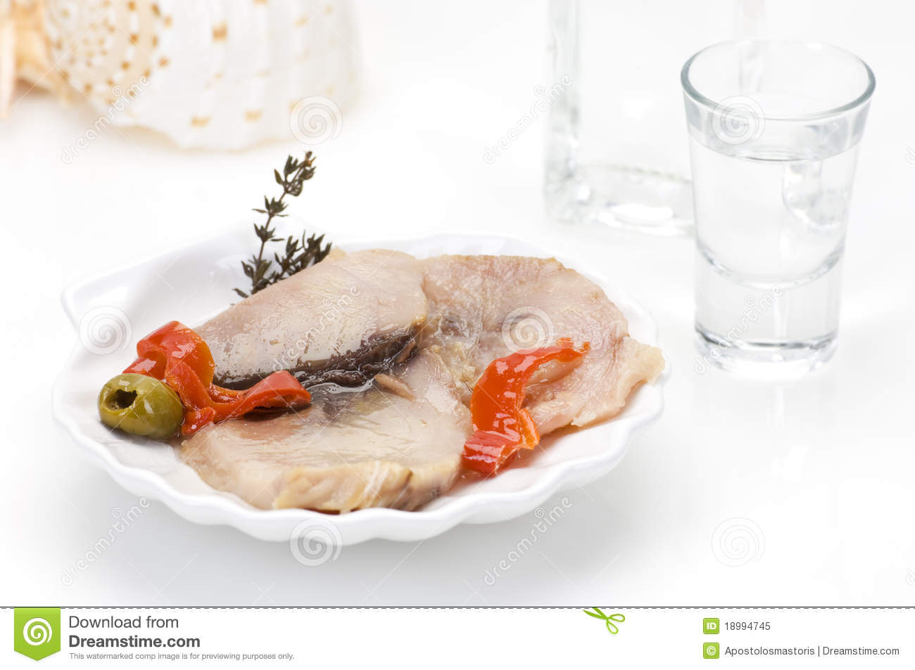 Smoked fish fillet and ouzo