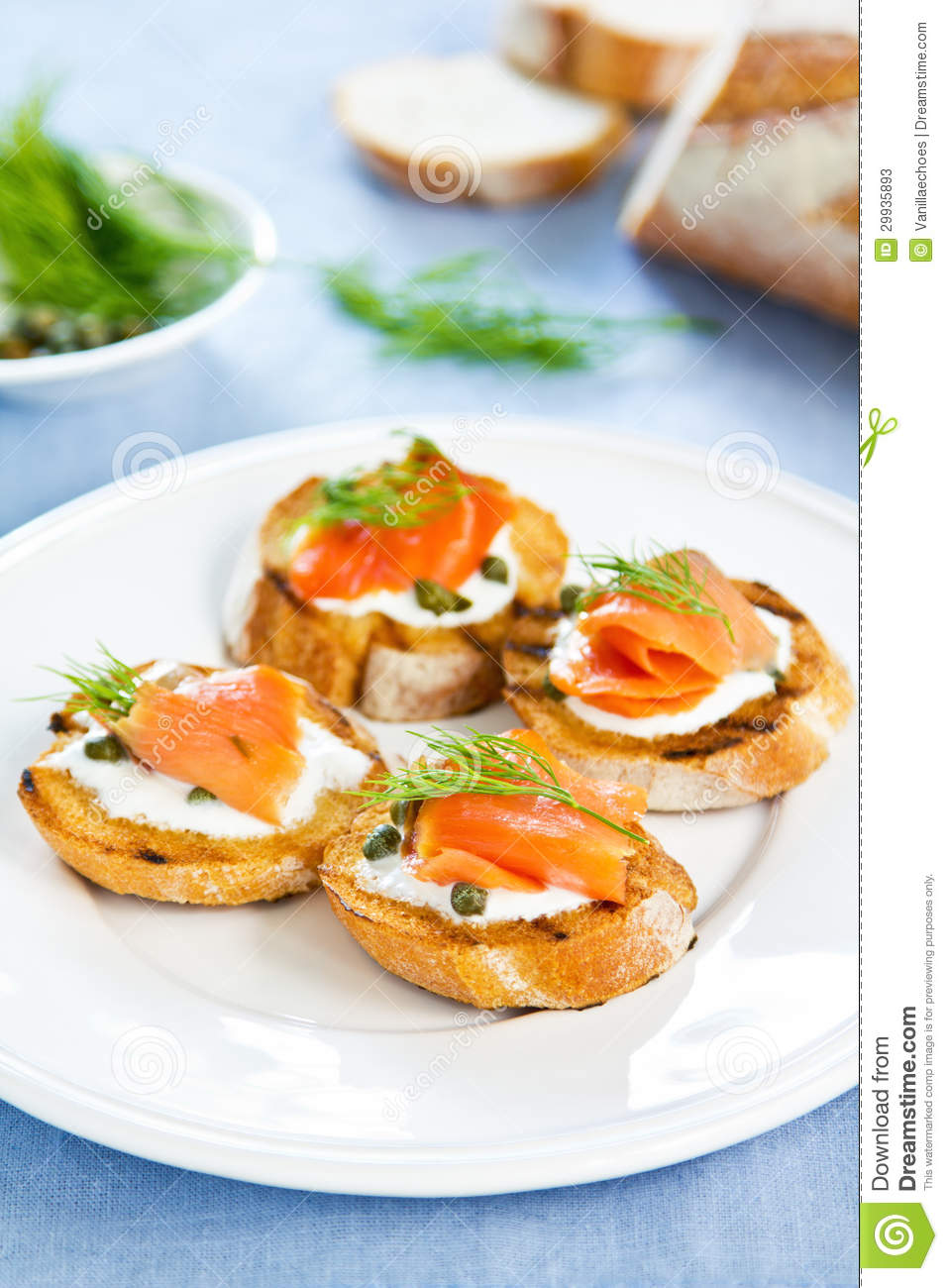 Smoked salmon crostini with cheese,caper and dill.