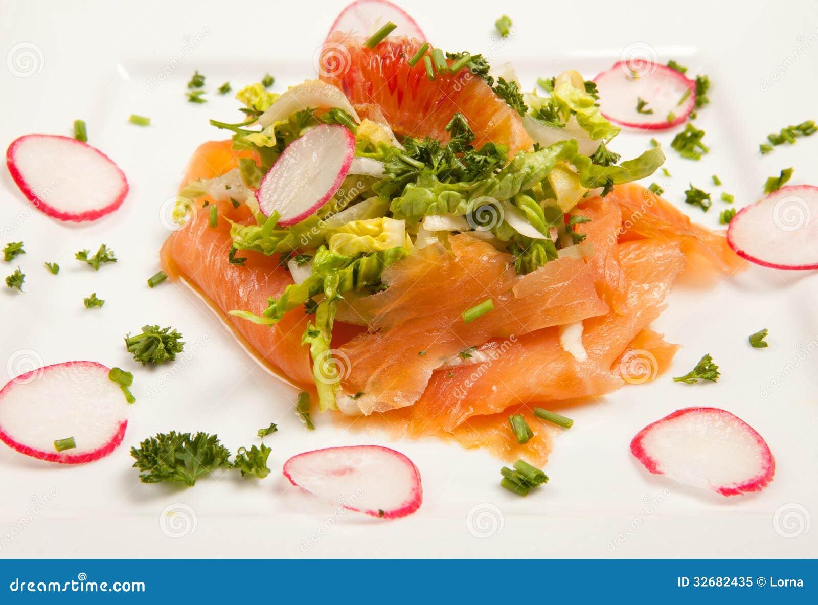 ... smoked salmon salad with blood orange and radish. seafood appetizer