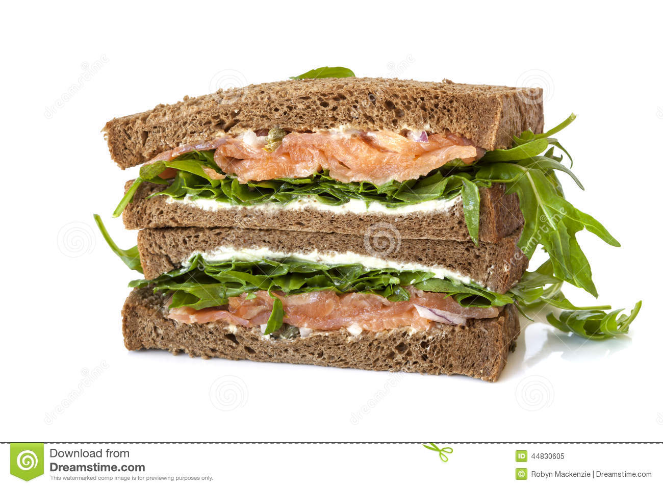 Smoked salmon sandwich on rye with arugula, cream cheese and capers ...