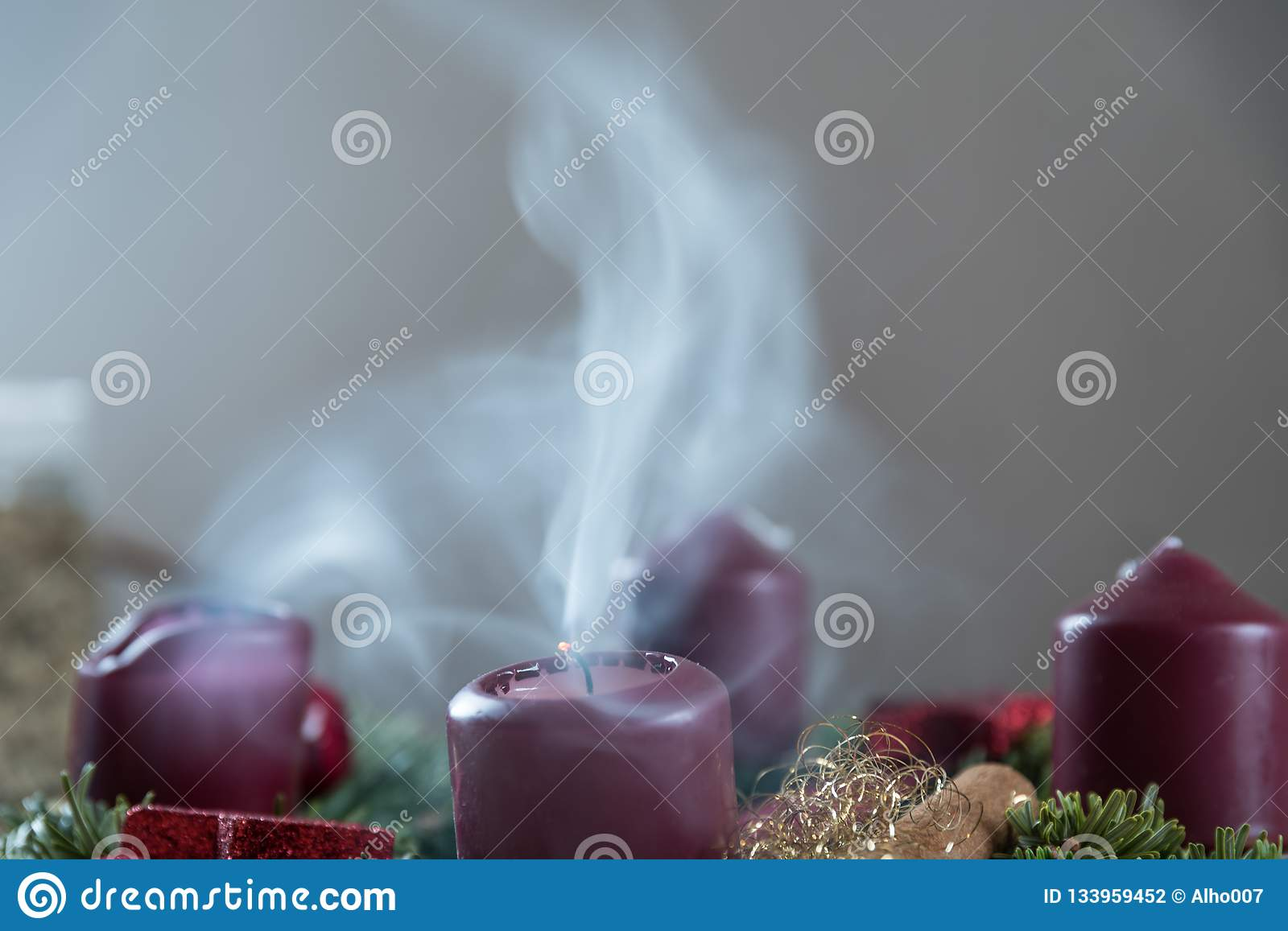 Smoking candle on Advent wreath