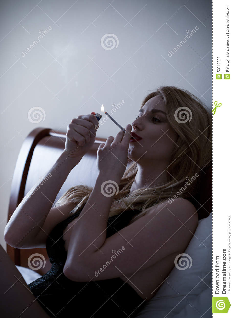 https://thumbs.dreamstime.com/z/smoking-cigarette-bed-young-sexy-woman-53012838.jpg
