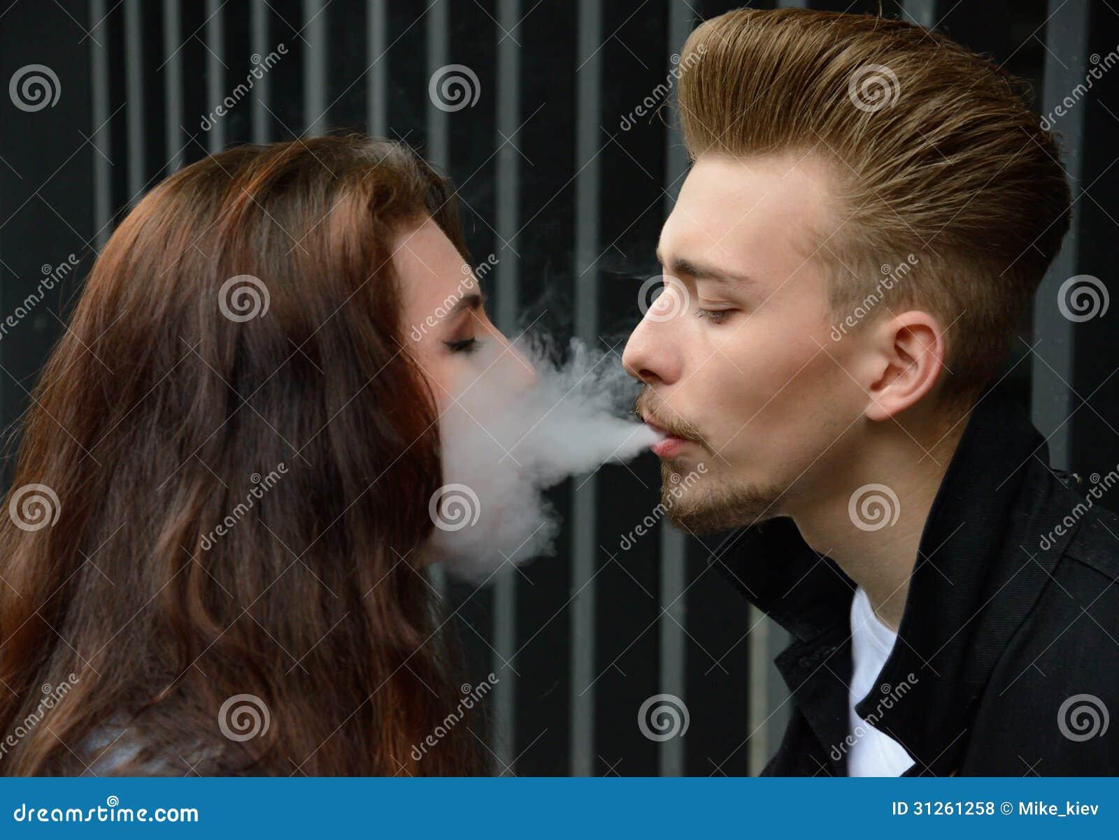 women kissing and smoking