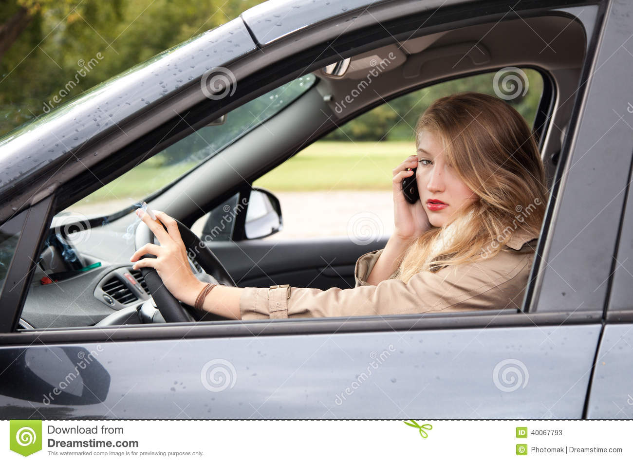 smoking woman driving a car and speaking on the phone stock photo   image 40067793