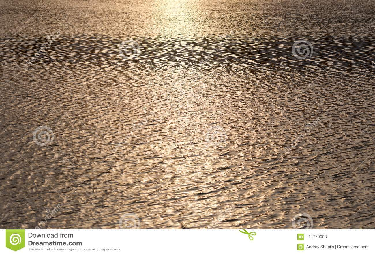 Smooth surface of the water at sunset