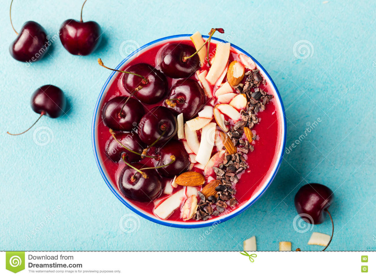 Smoothie Bowl With Fresh Black Cherries, Coconut Flakes, Almond And Cocoa Nibs. Top View. Copy Space Stock Image
