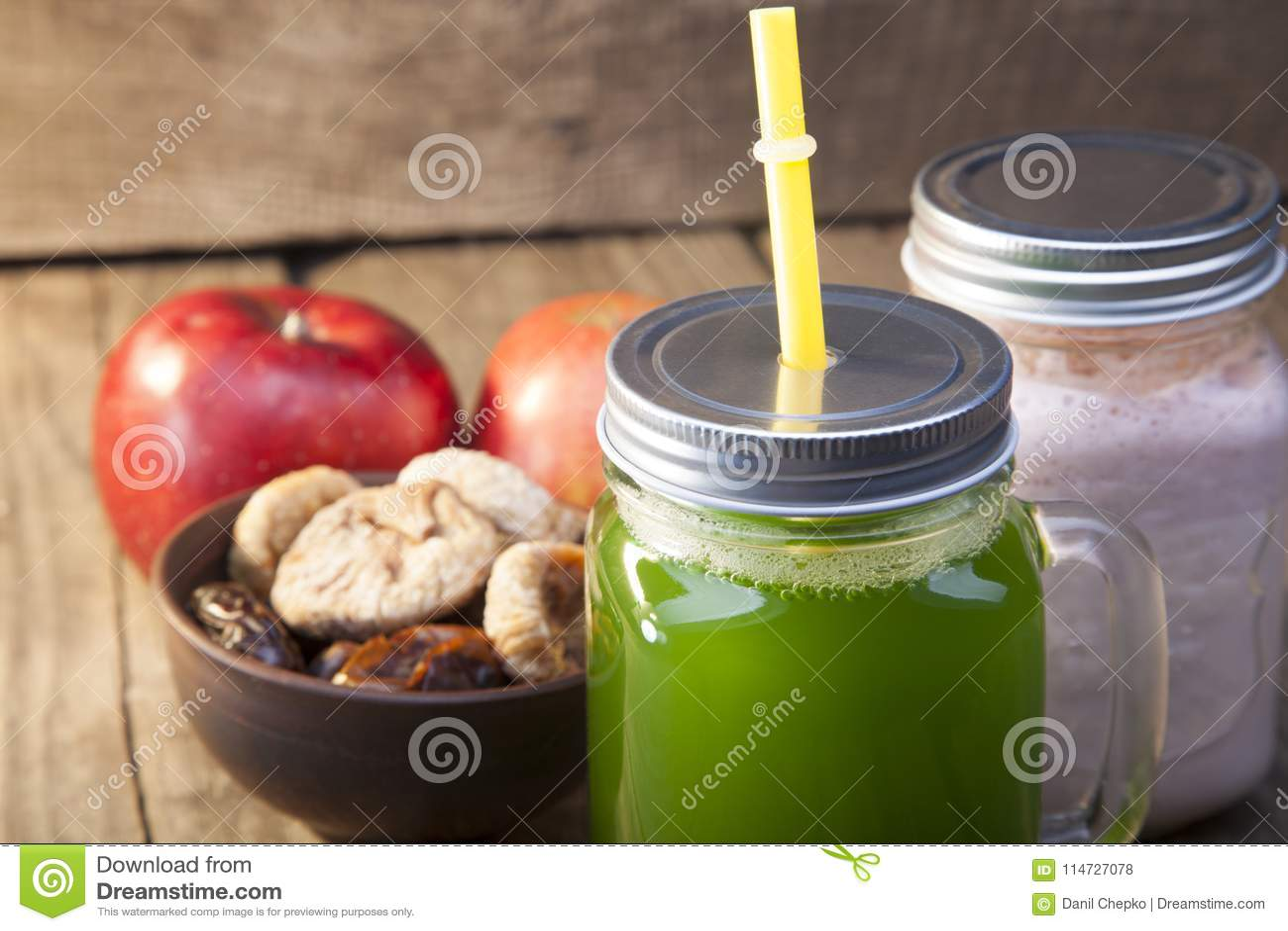 Smoothie in glass jar on rustik wood. Green healthy beverage and