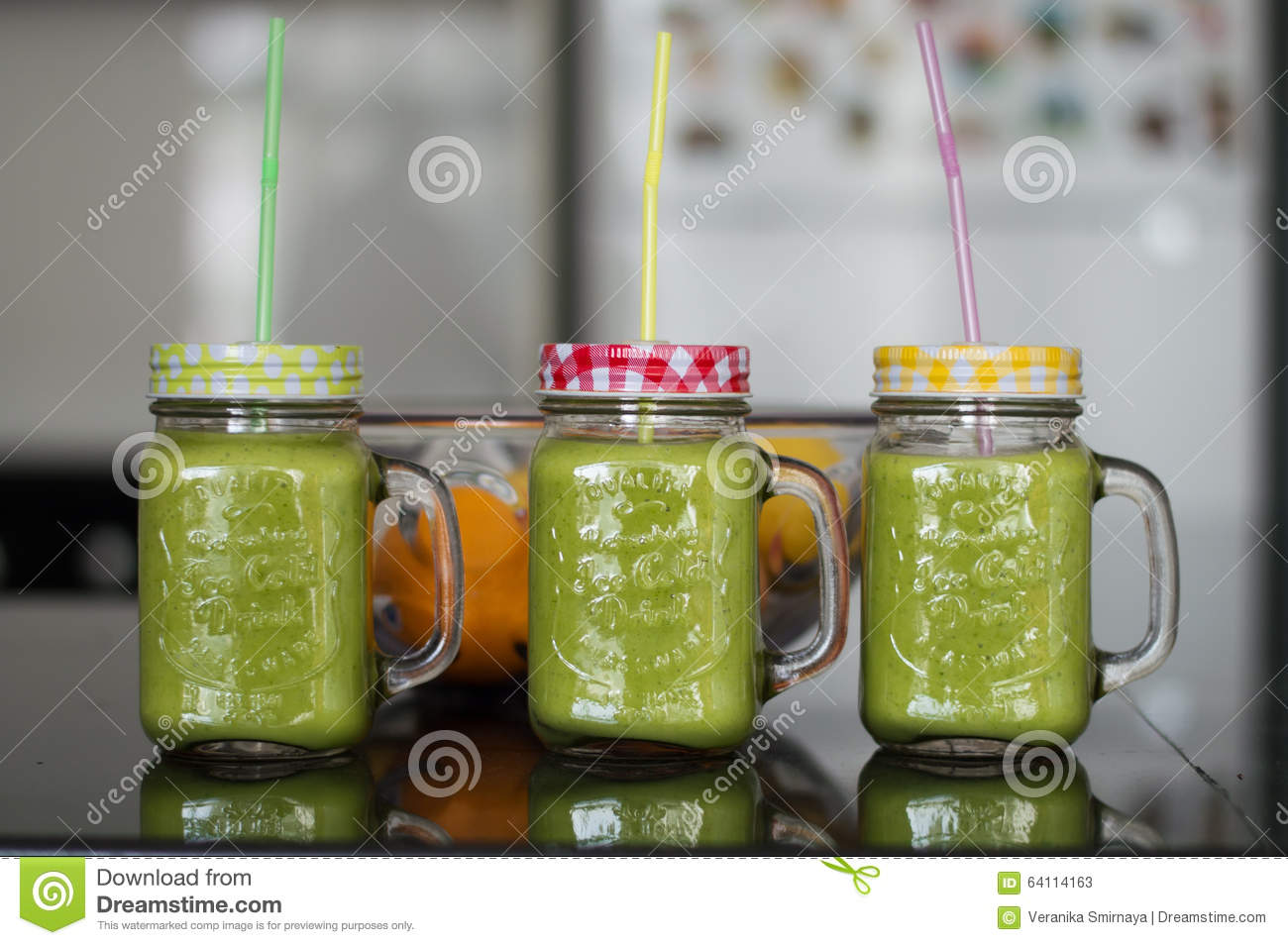 Smoothie in glasses with straws