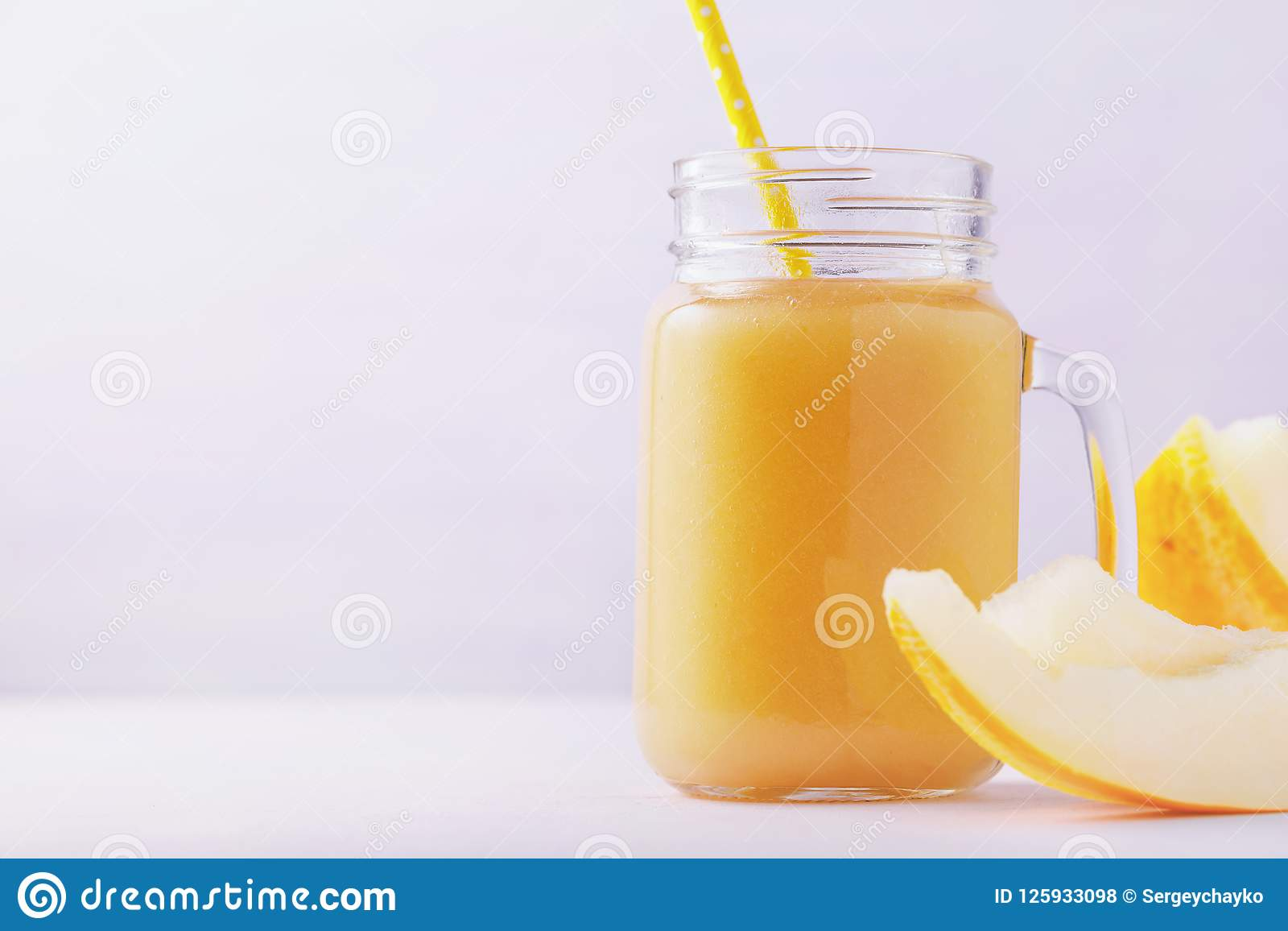 Smoothies cooked from ripe melon in a glass jar