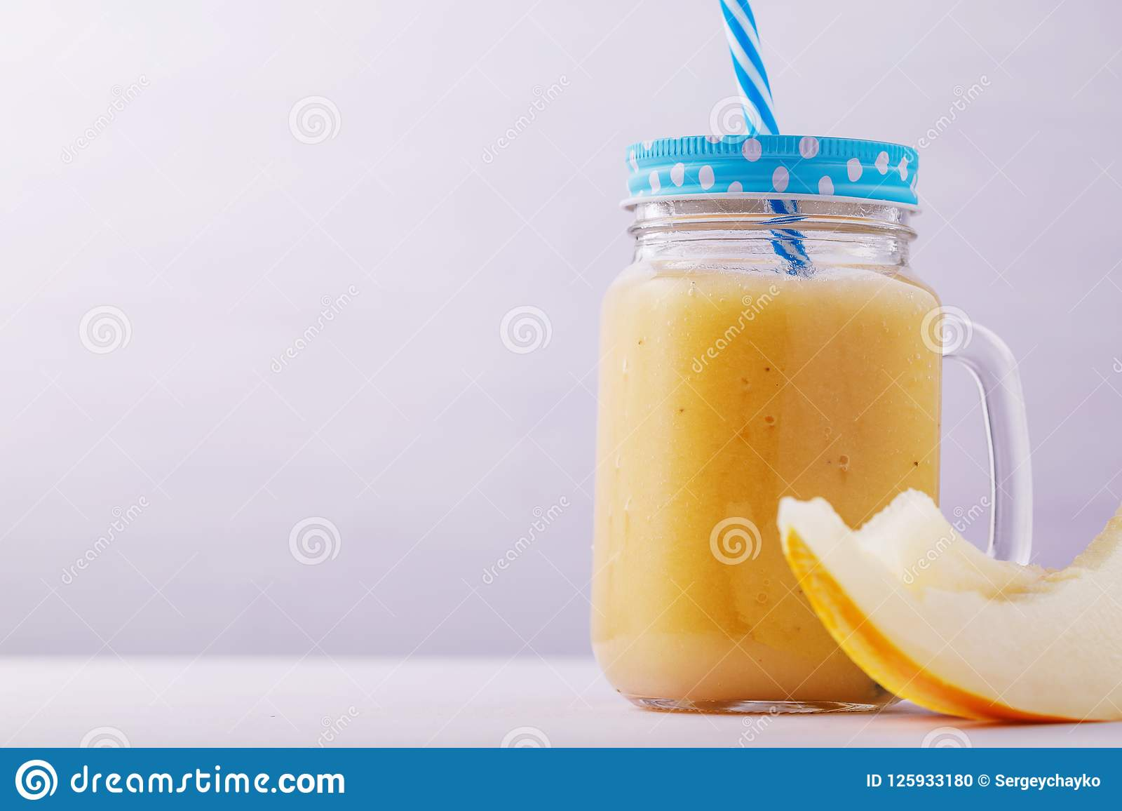 Smoothies in a glass jar, made from pieces of melon