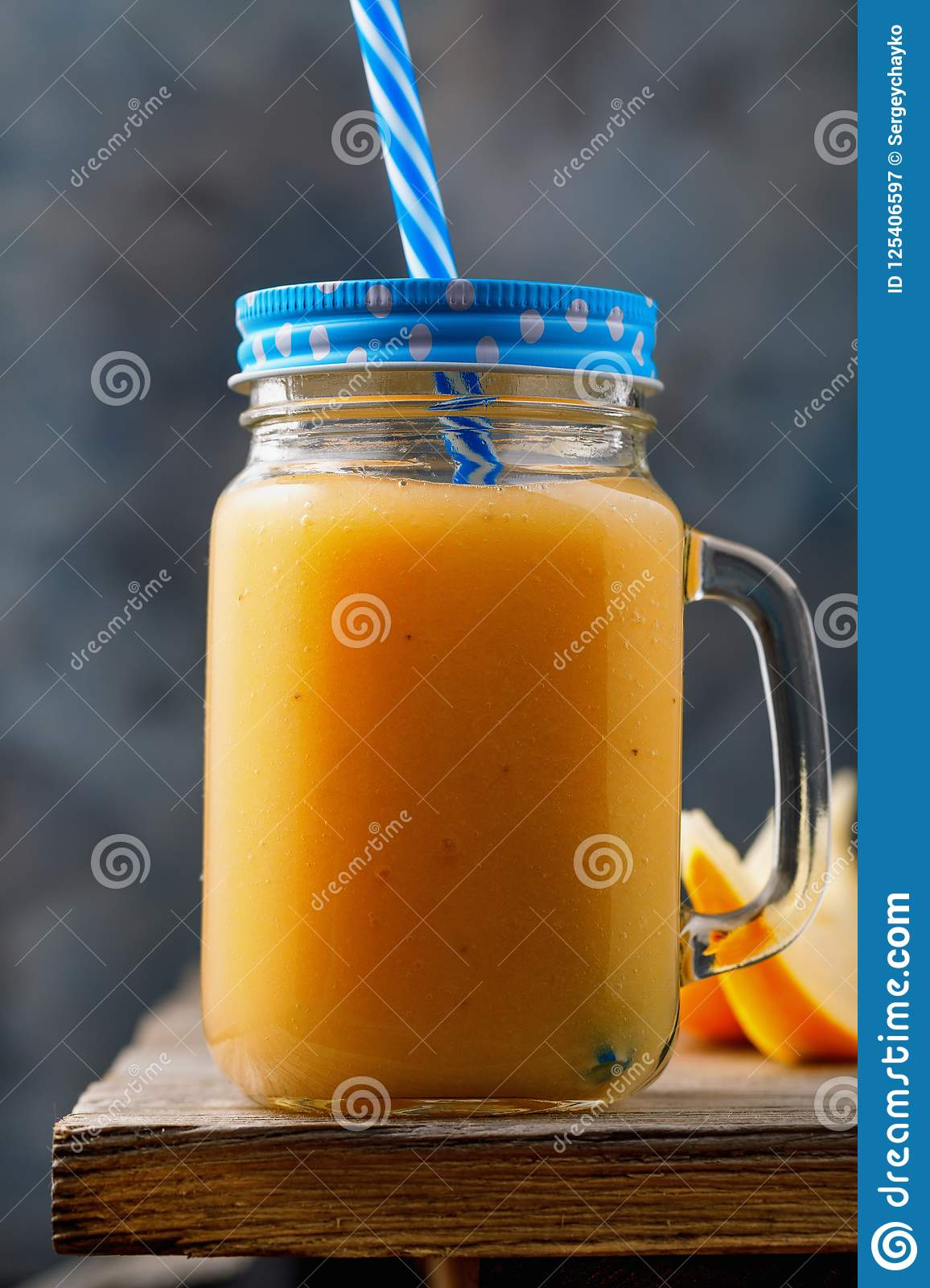Smoothies made from ripe melon. Drink in a jar on a wooden table