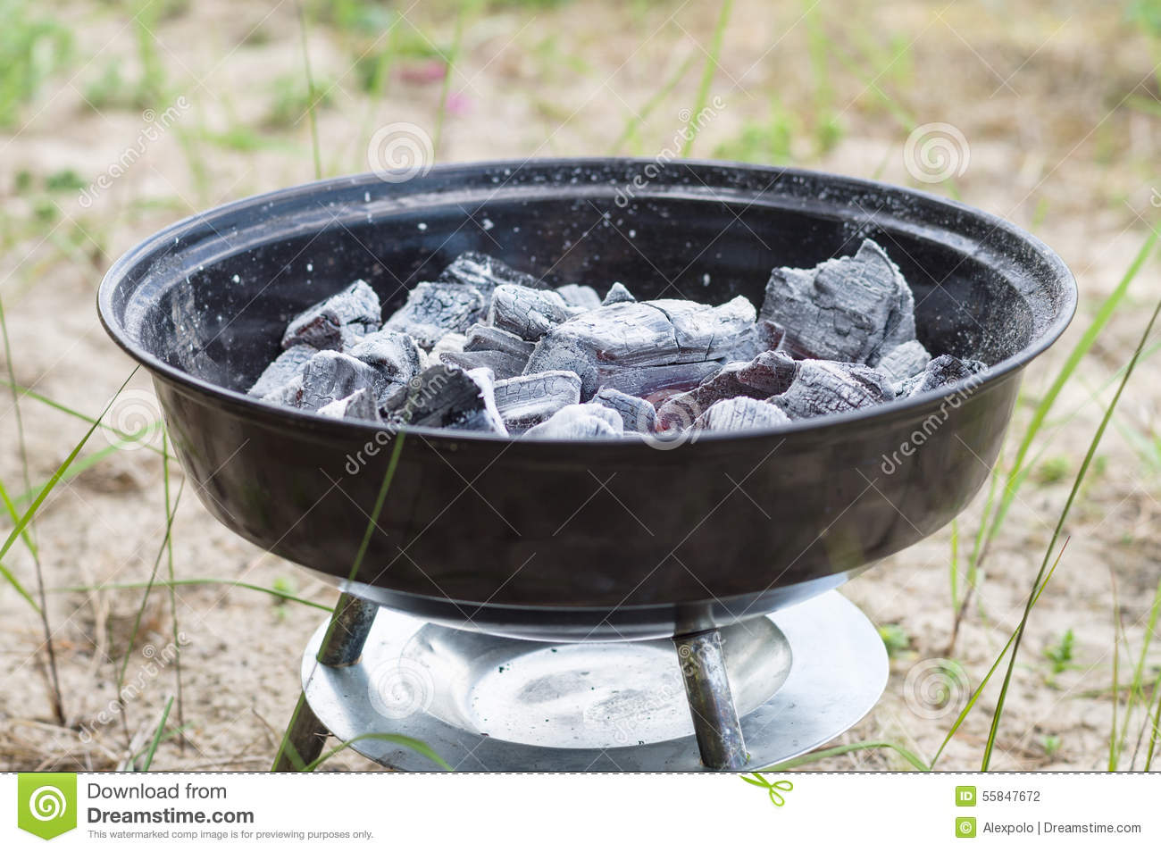 Smouldering charcoal in small grill stock photography