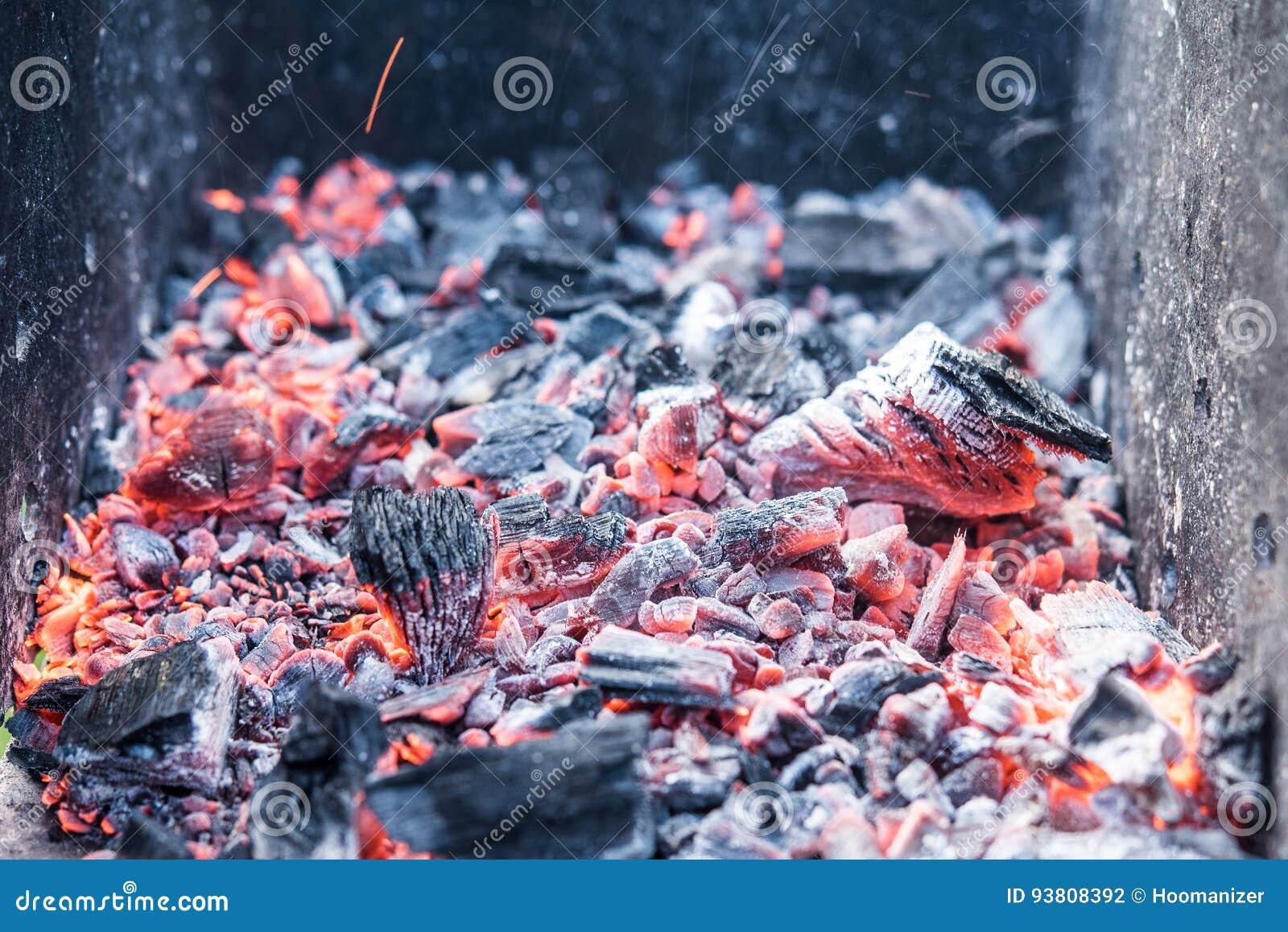 Smouldering coals at barbeque campfire