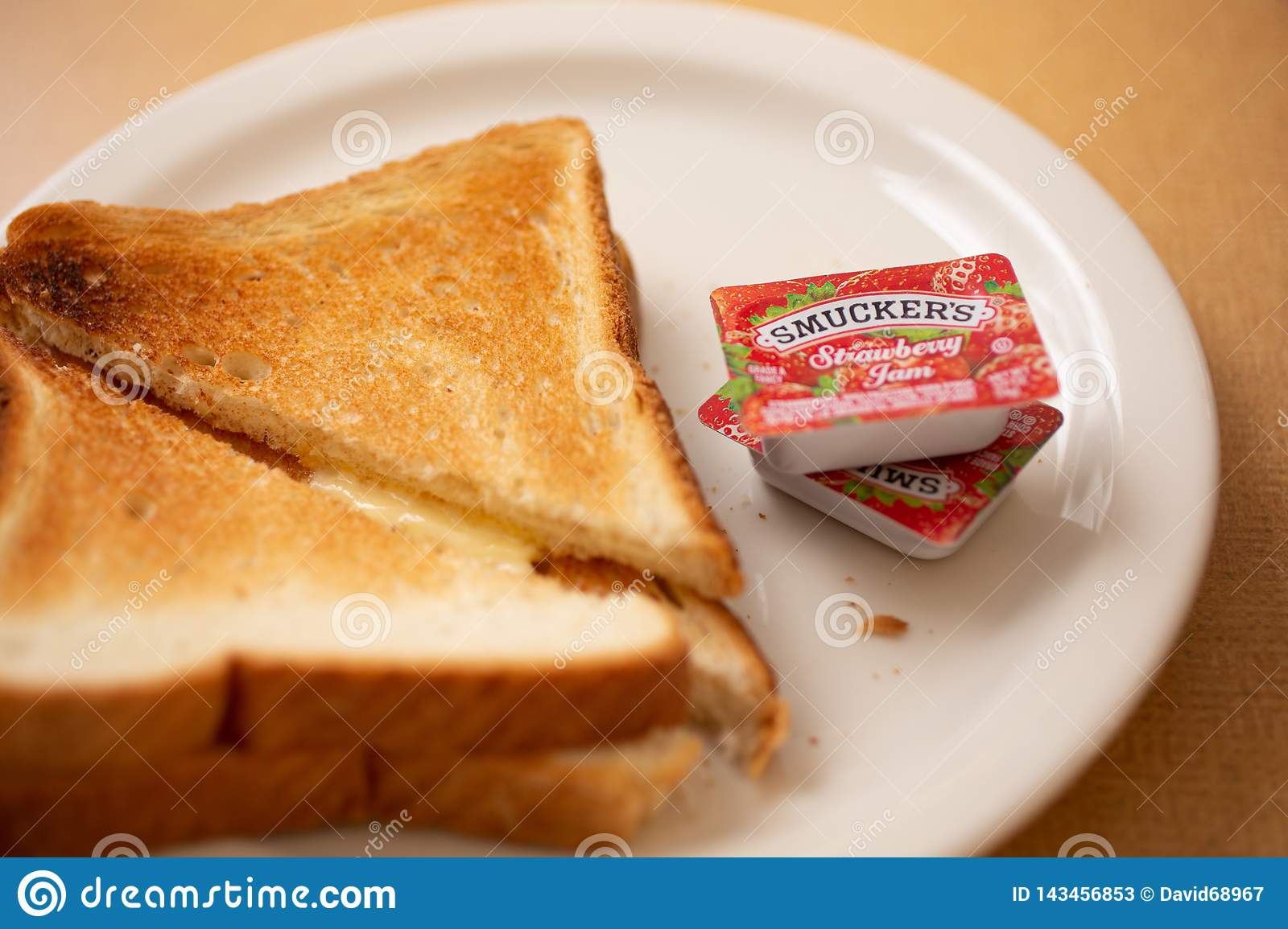 Smuckers jam and toast at a restaurant