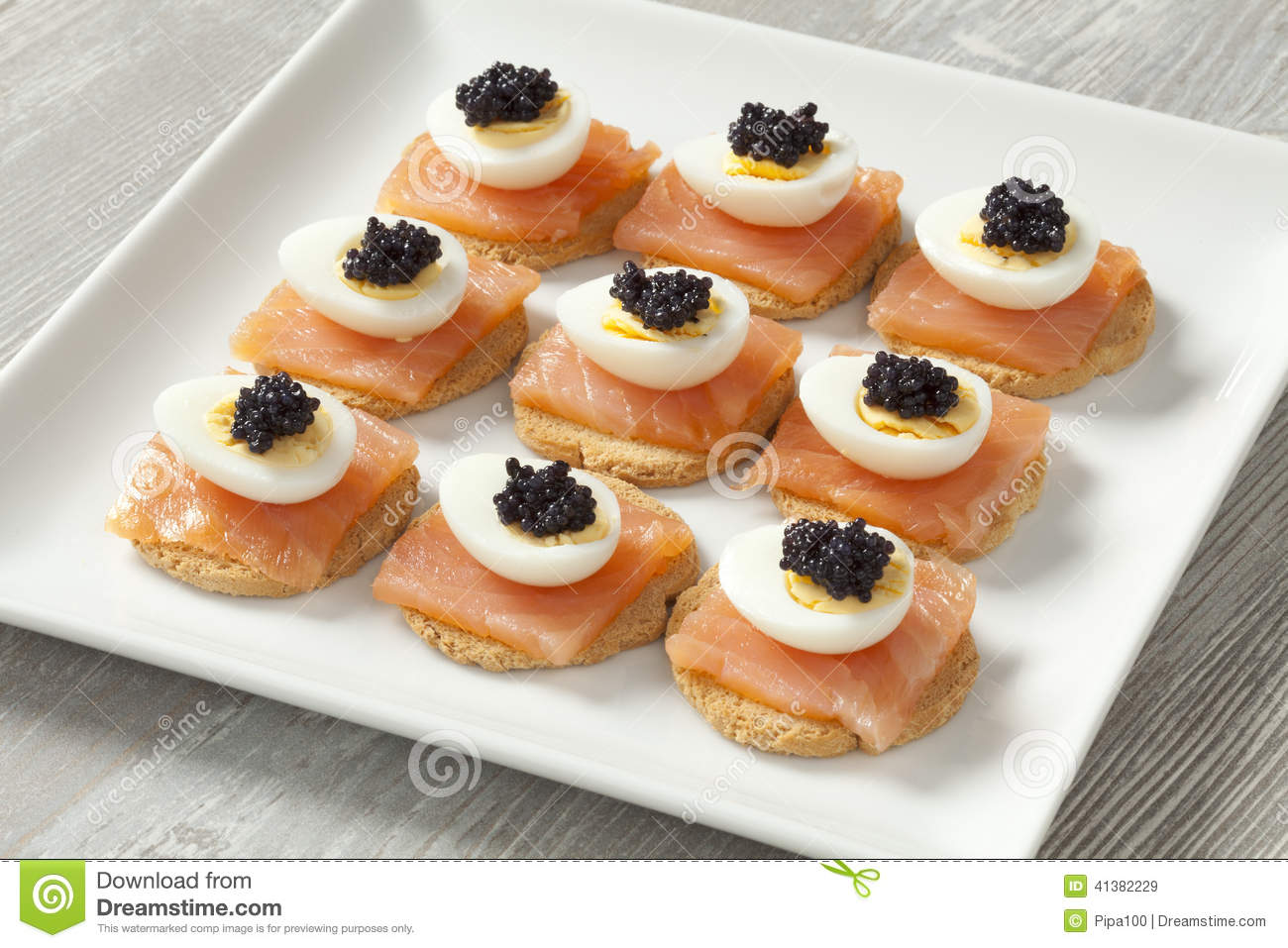 Snack with salmon quail eggs and lumpfish roe stock photo for Canape de salmon