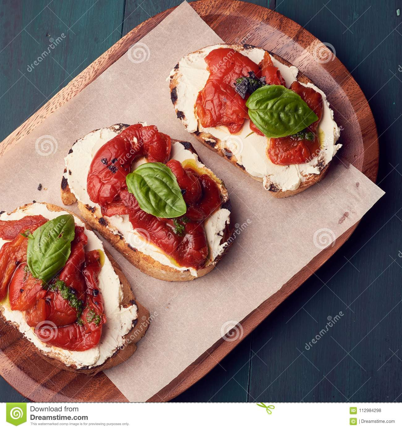 Snack set. Brushetta with cherry tomatoes, garlic, cream cheese and basil. Slow food, party food concept